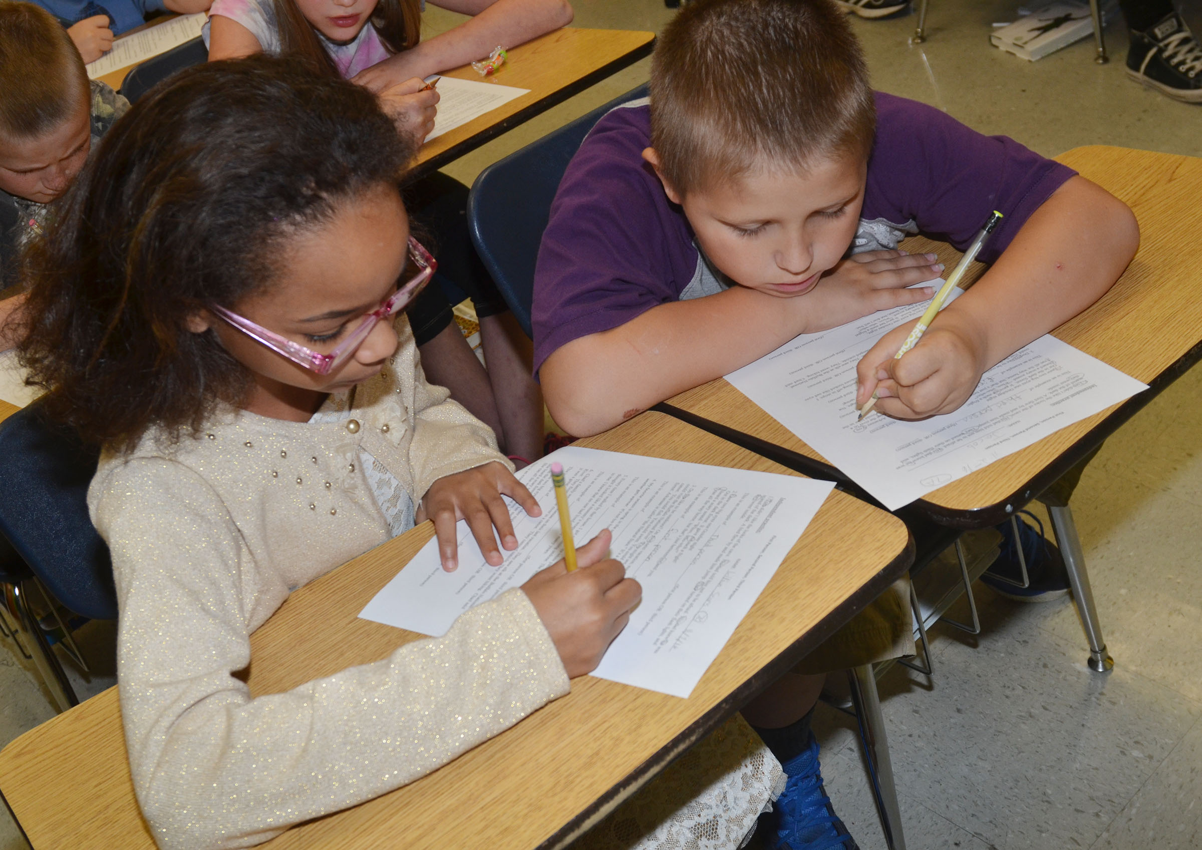 CMS fourth-graders Lillian Sears and Jacob Simpson read a passage to determine what point of view in which they believe it is written.