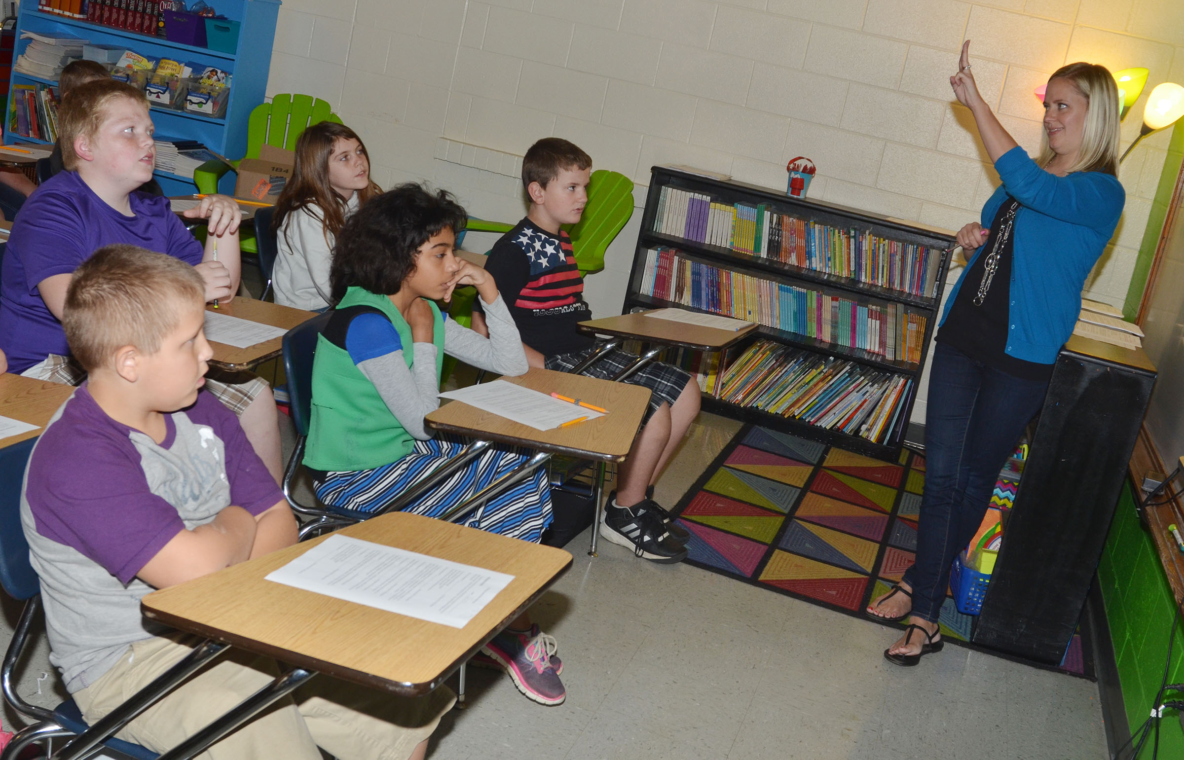 CMS fourth-grade teacher Maranda Wright talks to her class about the three points of view in a story.