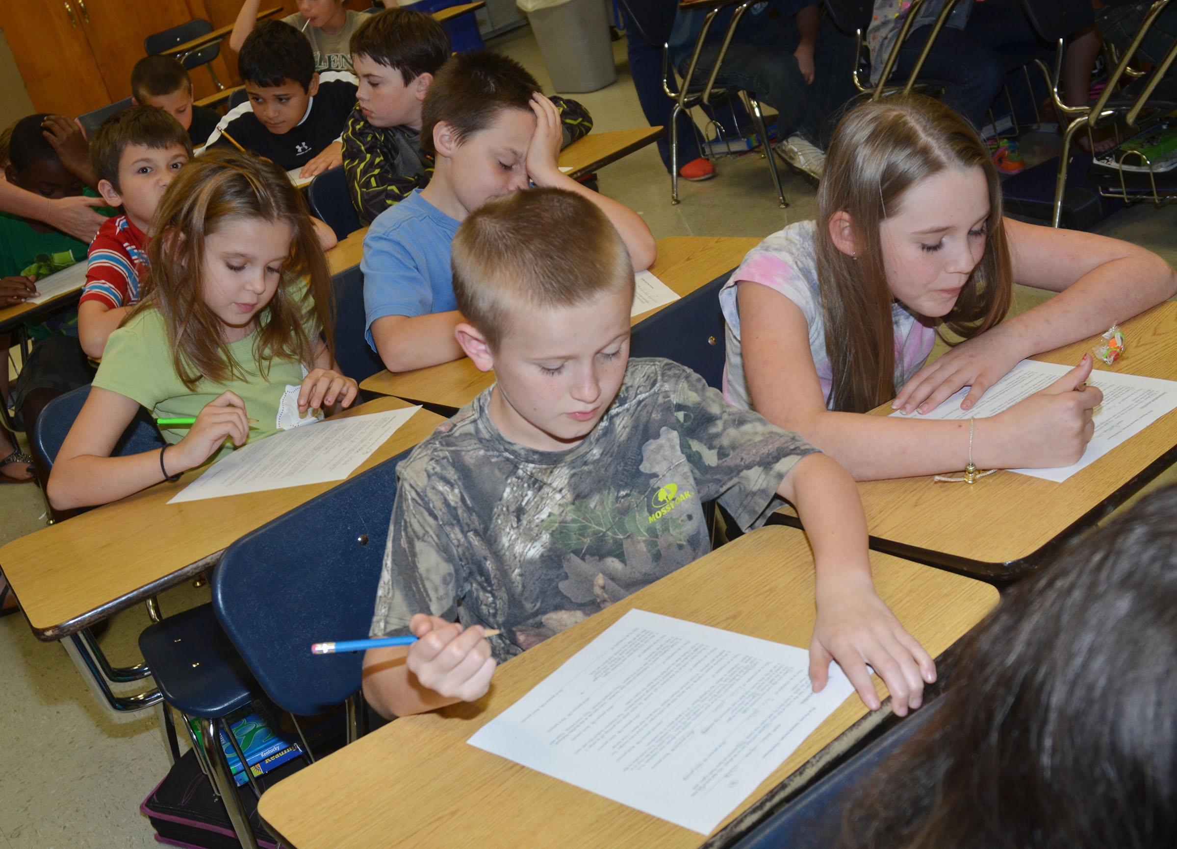 CMS fourth-graders Arthur Singleton and Brooklynn Giles work to determine what point of view they believe their story is written.