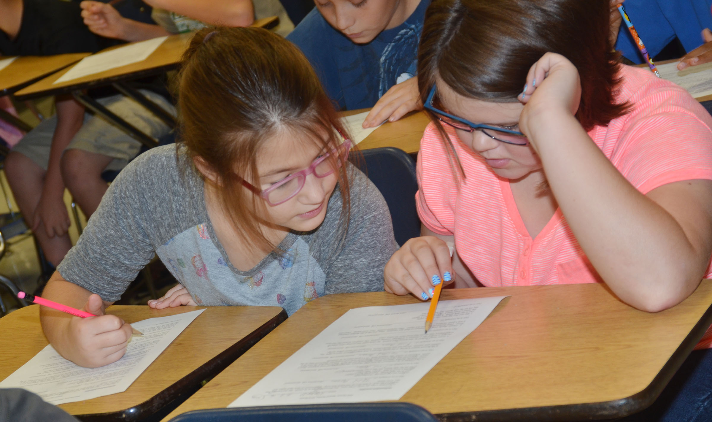 CMS fourth-graders Kylee Sowders, at left, and Keeley Dicken work together to determine in which point of view they believe their passage is written.