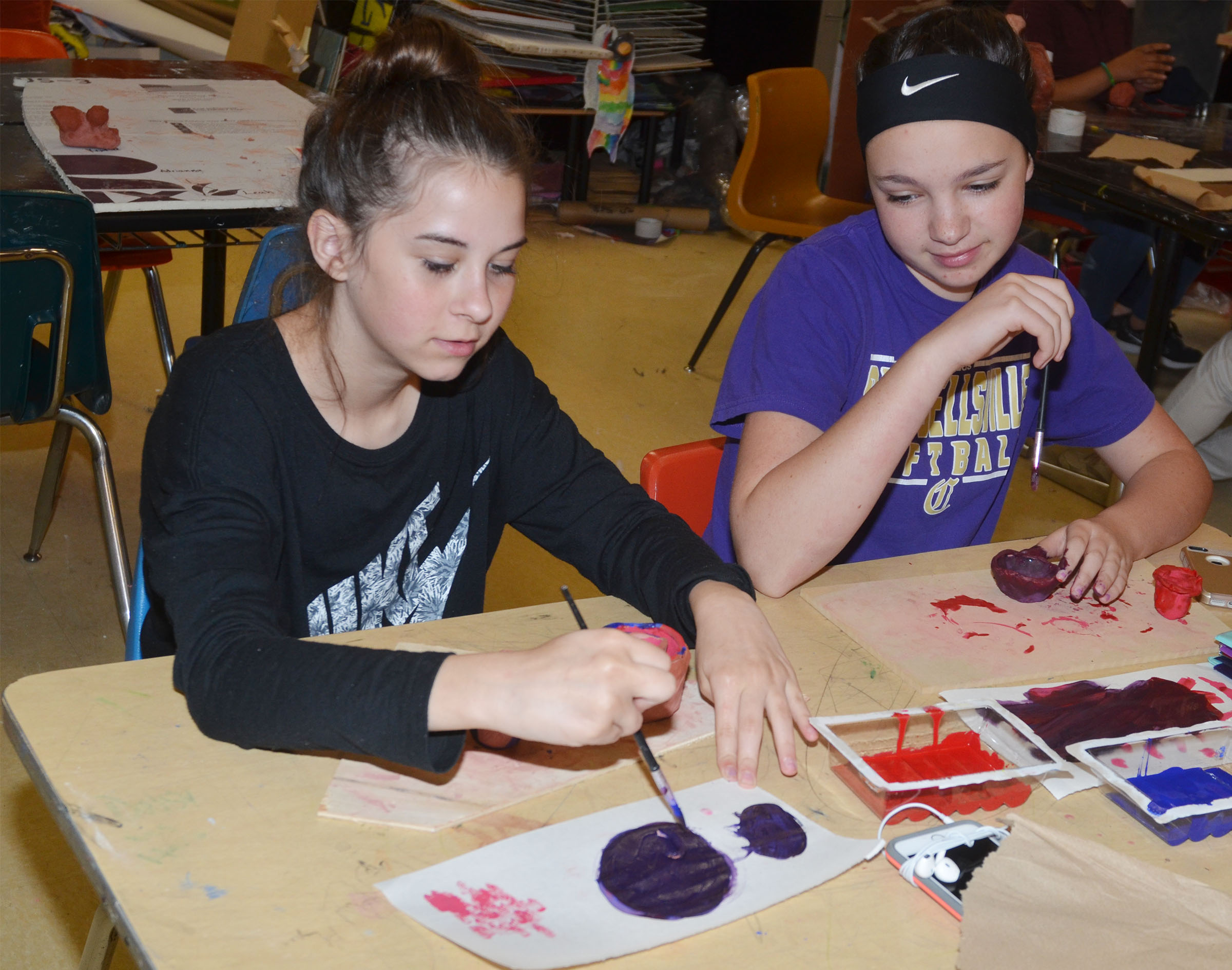 CMS seventh-graders Chloe Anderson, at left, and Karley Morris paint.
