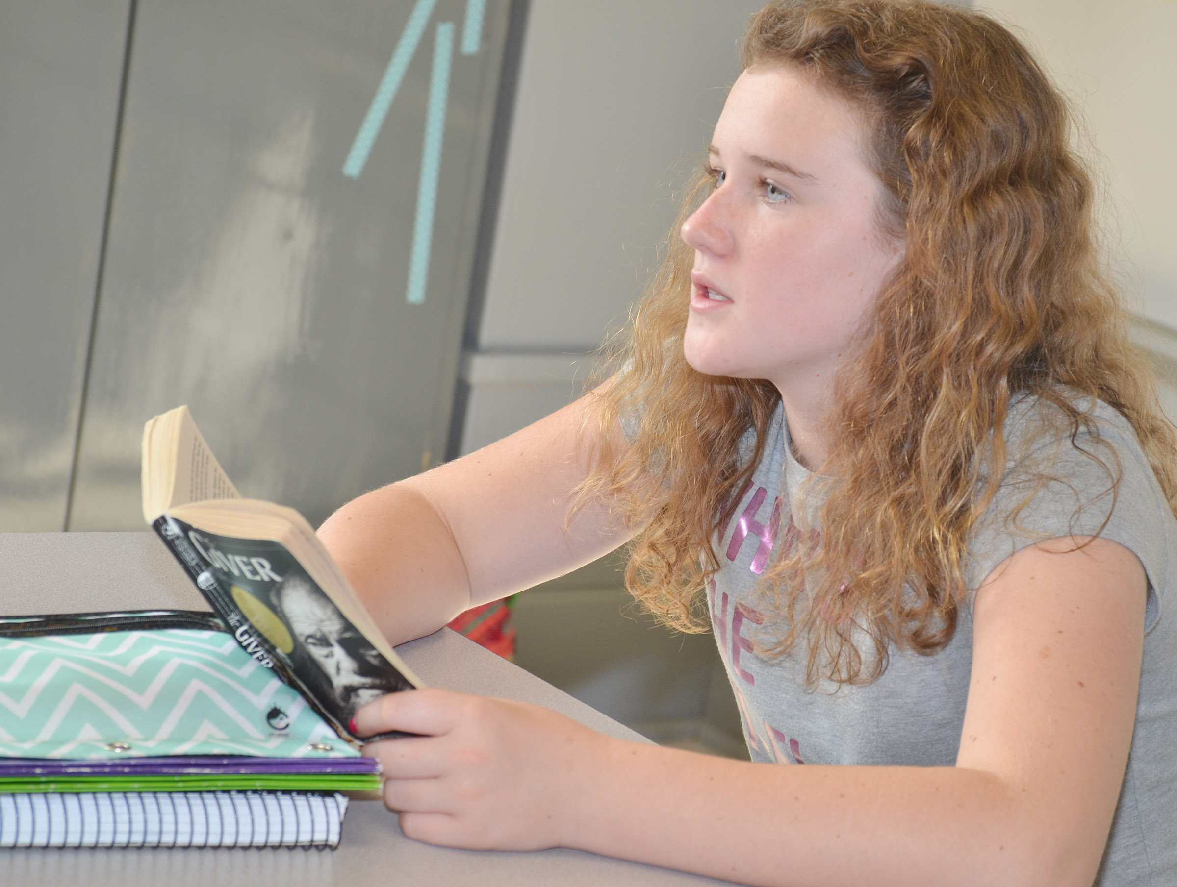 "CMS eighth-grader Abby Brisko reads ""The Giver."""