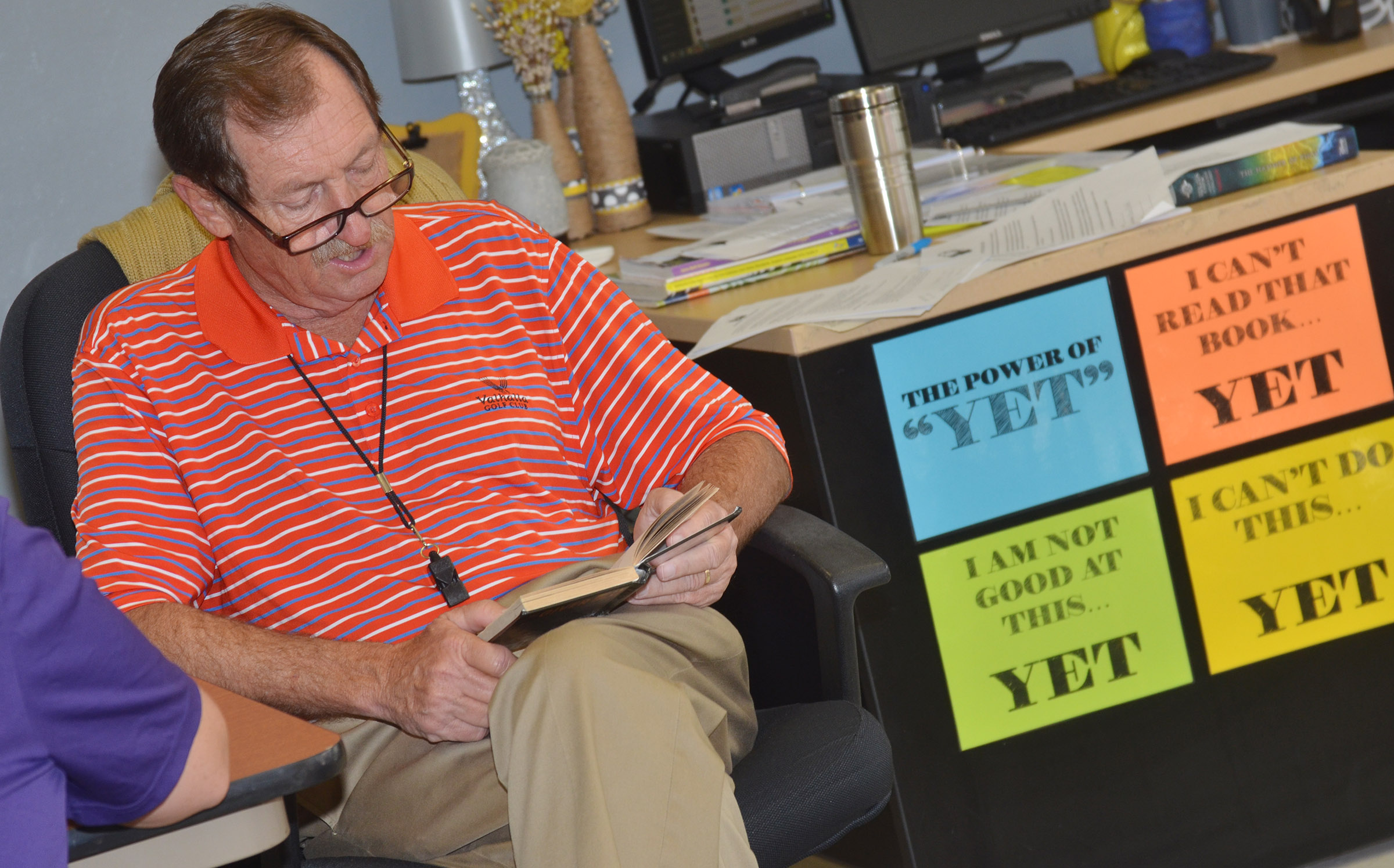 "CMS substitute teacher Greg Chick reads ""The Giver."""