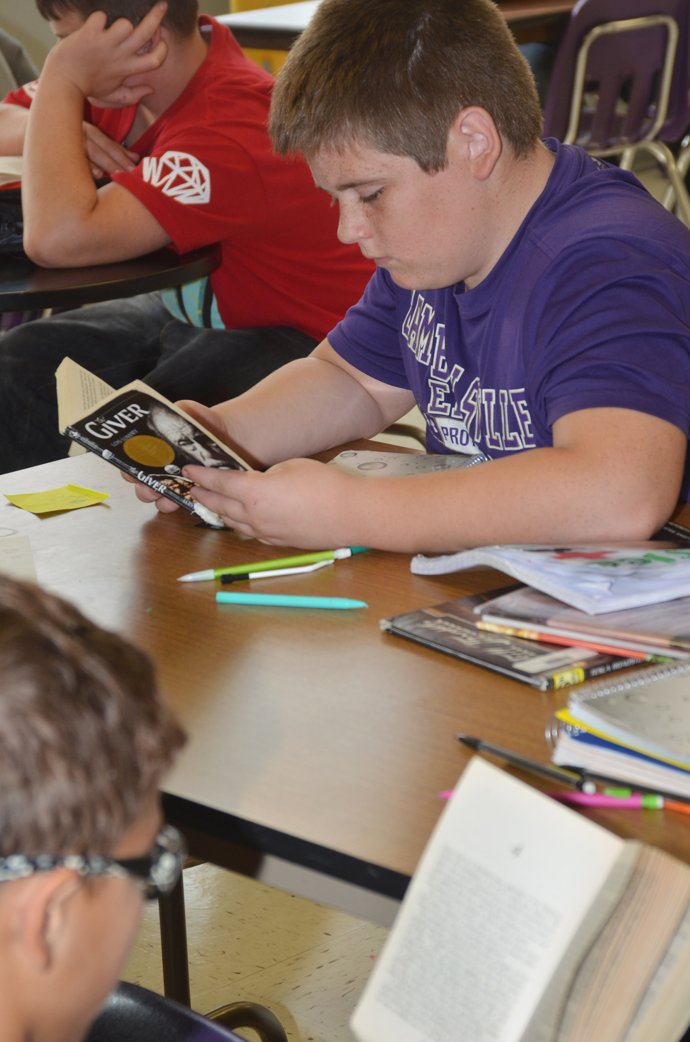 "CMS eighth-grader Zachery Underwood reads ""The Giver."""