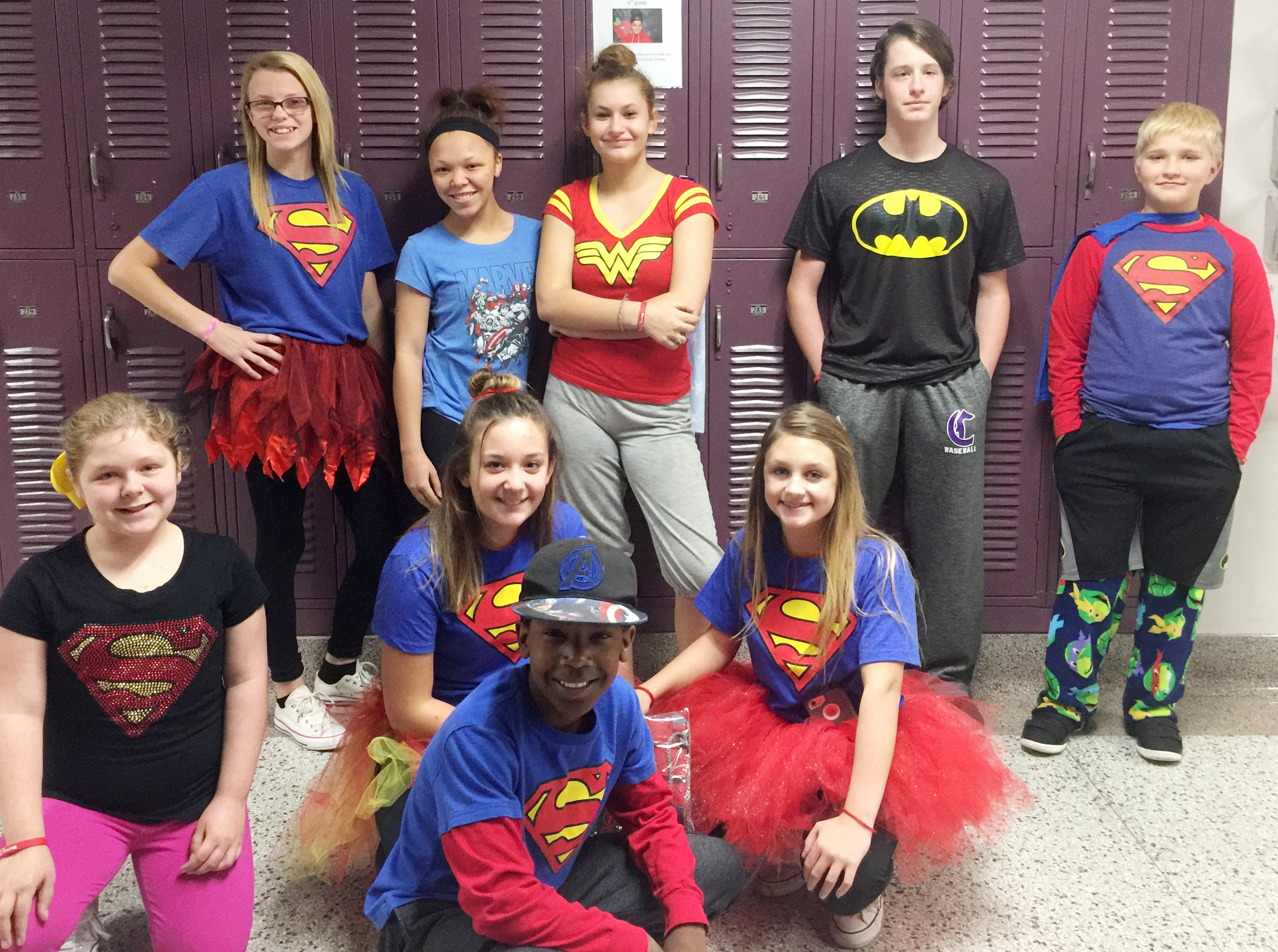 CMS students are celebrating Red Ribbon Week this week with several special events, including dress-up days. Winners for Thursday, which was Real Heroes Don't Do Drugs Day, were, from left, front, sixth-grader Alexis Sharp, seventh-grader Briana Davis, eighth-grader Jadan Furman and seventh-grader Alexis Byers. Back, seventh-graders Jade Wheeler, eighth-graders Kitana Taylor and Christina Miller, seventh-grader Seth Hash and sixth-grader Dakota Tungate.
