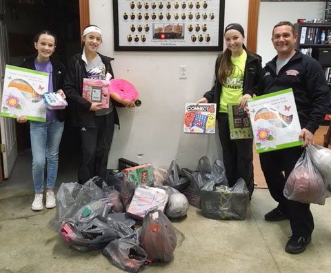 CMS Lighthouse Service Action Committee members recently purchased more than $300 worth of toys to be donated to Campbellsville Fire & Rescue's annual Toys for Kids effort. Members are, from left, seventh-graders Sarah Adkins, Kaylyn Smith and Lainey Watson, with Captain Keith Bricken. Absent from the photo is Riley Rainwater.