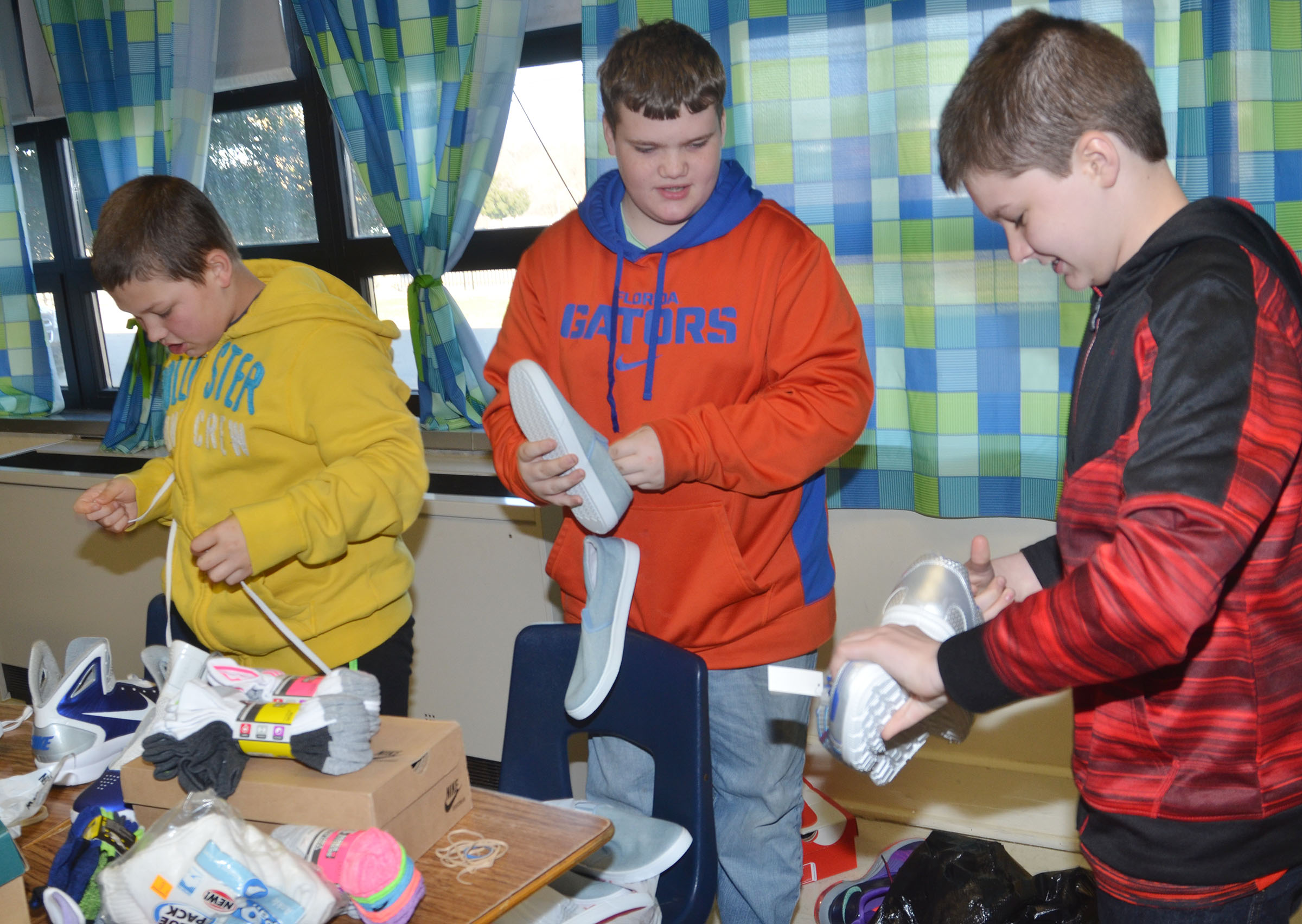 CMS sixth-graders sort through shoes.