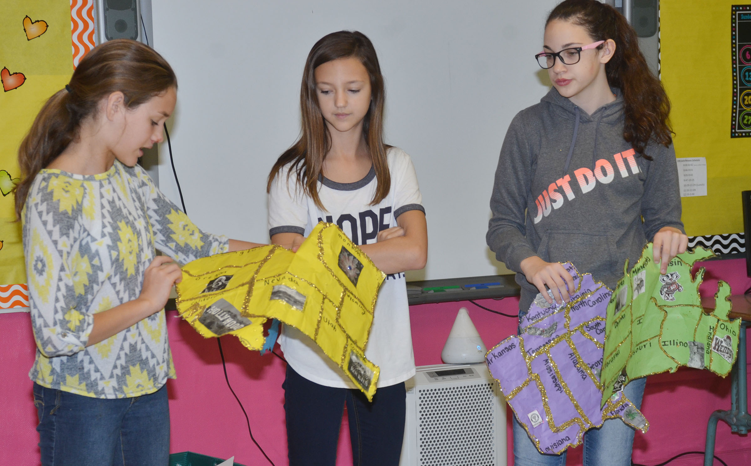 From left, CMS sixth-graders Haylee Allen, Bri Hayes and Mary Russell discuss their map.