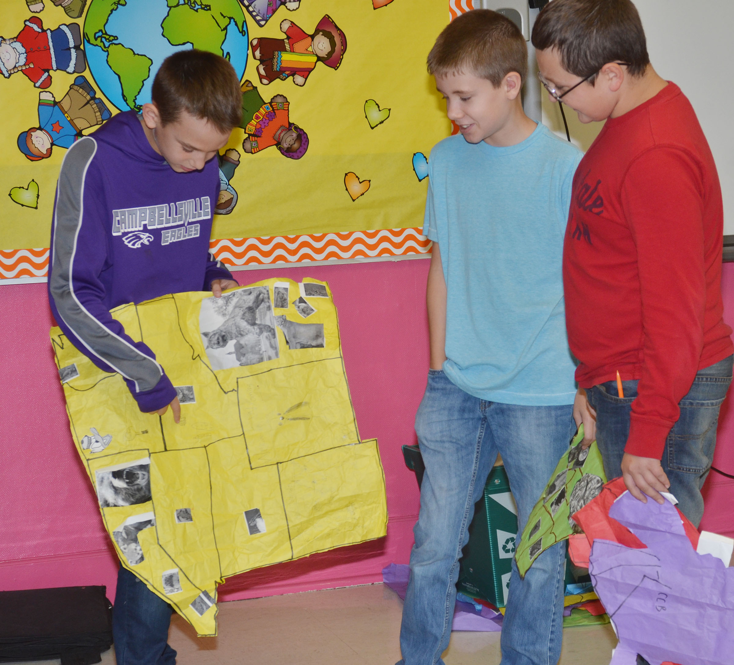 CMS sixth-graders, from left, Camren Vicari, Blake Tungate and Cameron Mahan discuss their map.
