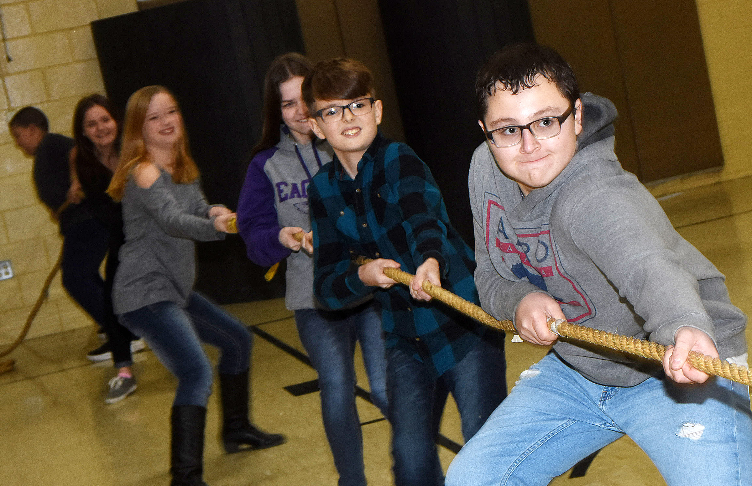 CMS eighth-graders Kanon Durham, at left, and Cameron Mahan lead their team as they play tug of war.