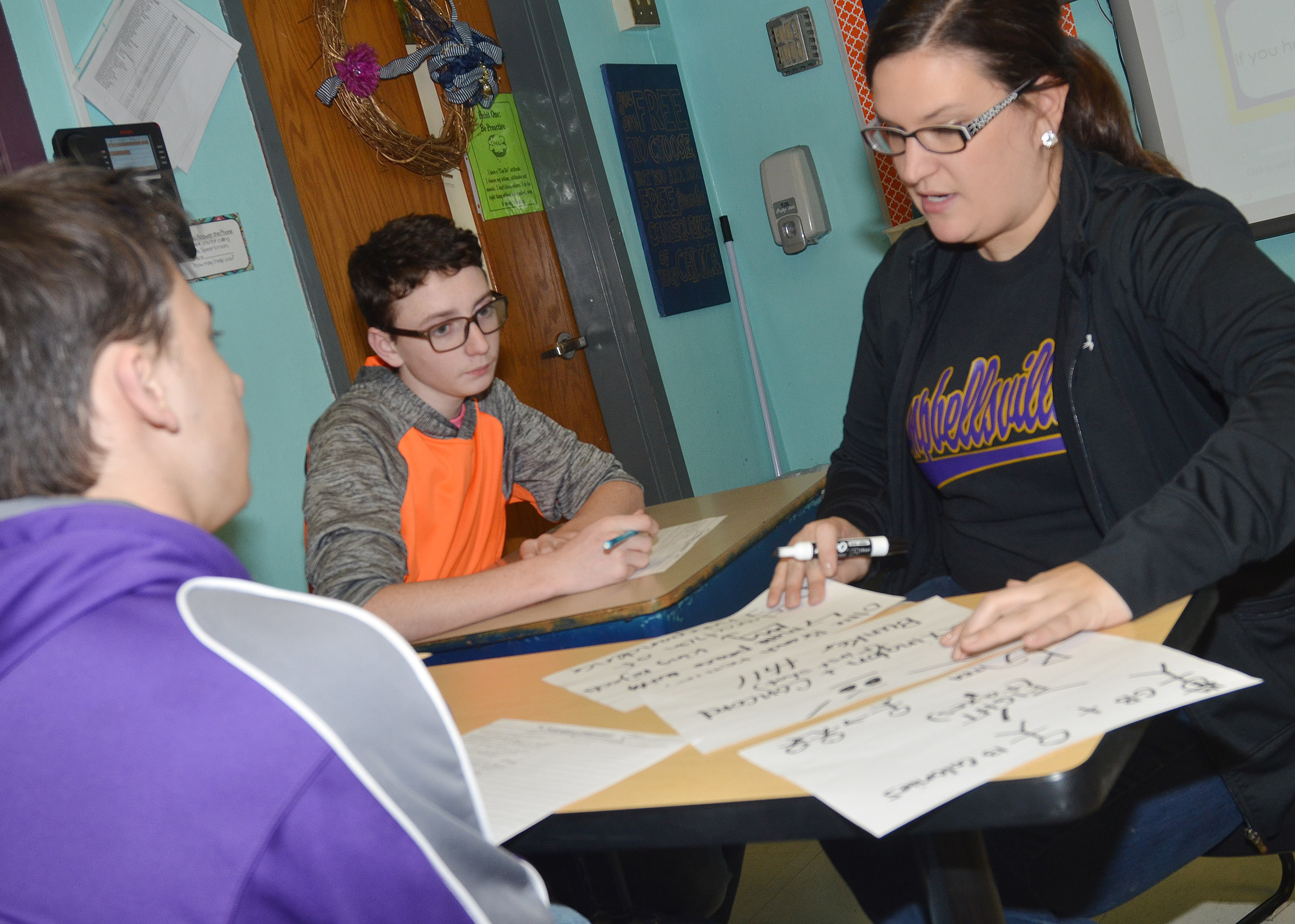 CMS eighth-grade social studies teacher Robbilyn Speer explains to students Jonathan Foster, at left, and Jonathan Sparks how the American Revolution can be compared to a couple ending their relationship.