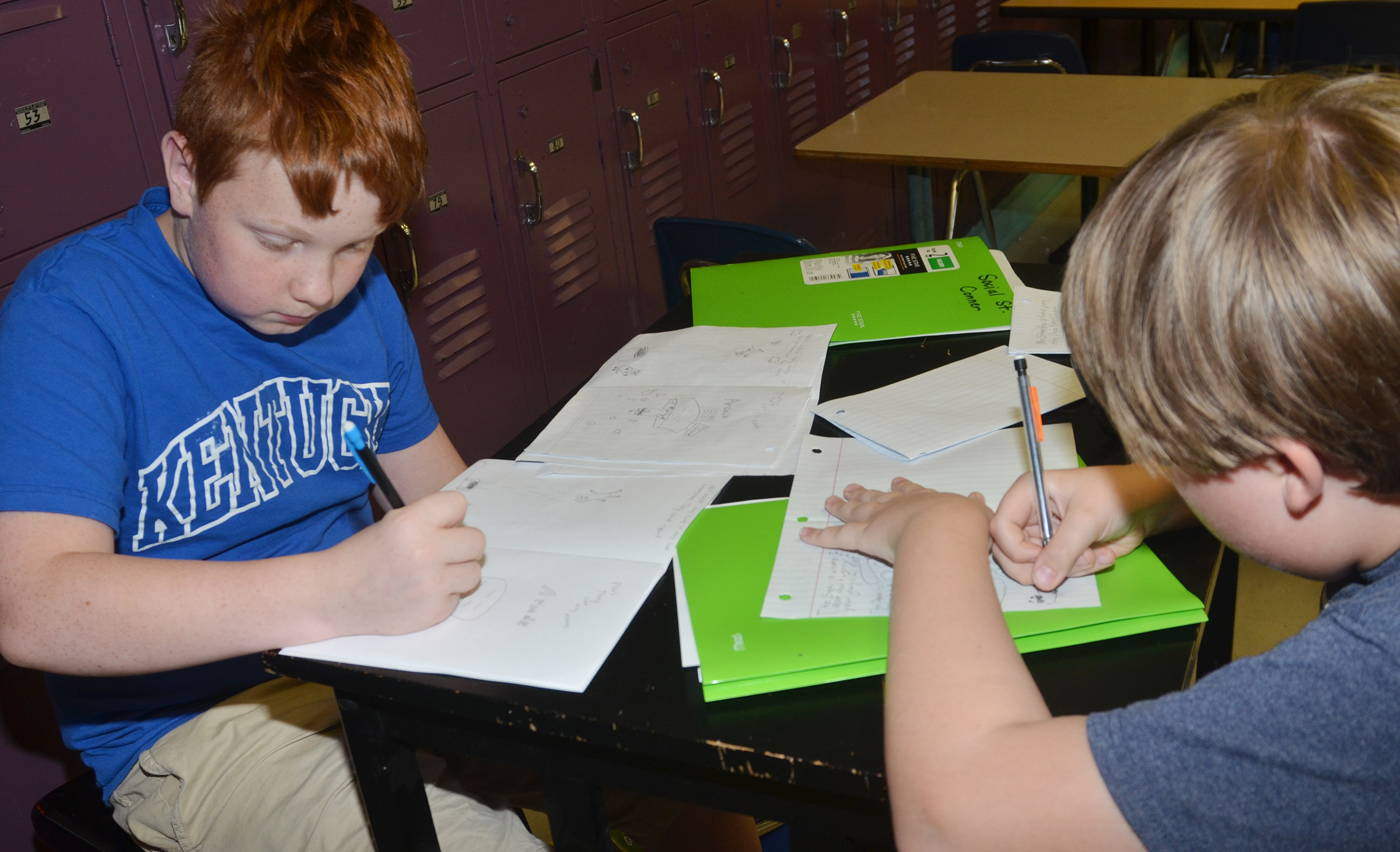 CMS sixth-graders Conner Rinehart, at left, and Zachary Akin draw their children's books.