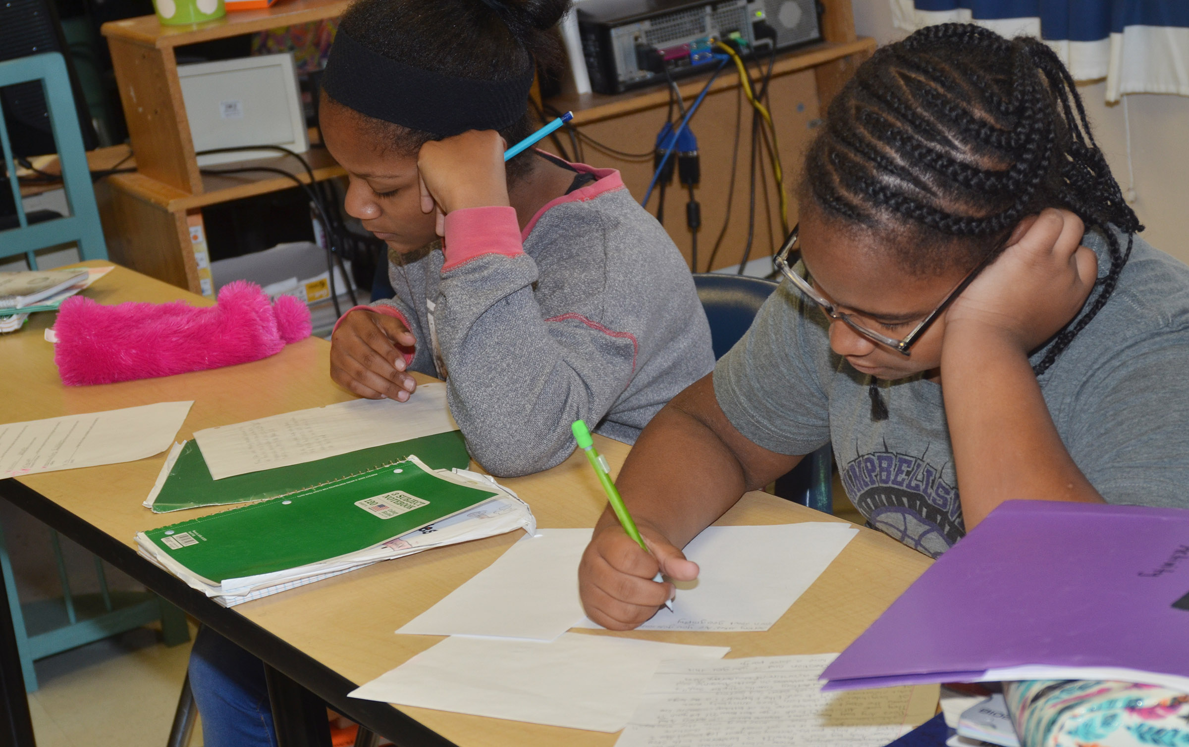 CMS sixth-graders Camilla Taylor, at left, and KyAshia Mitchell draw their children's books.