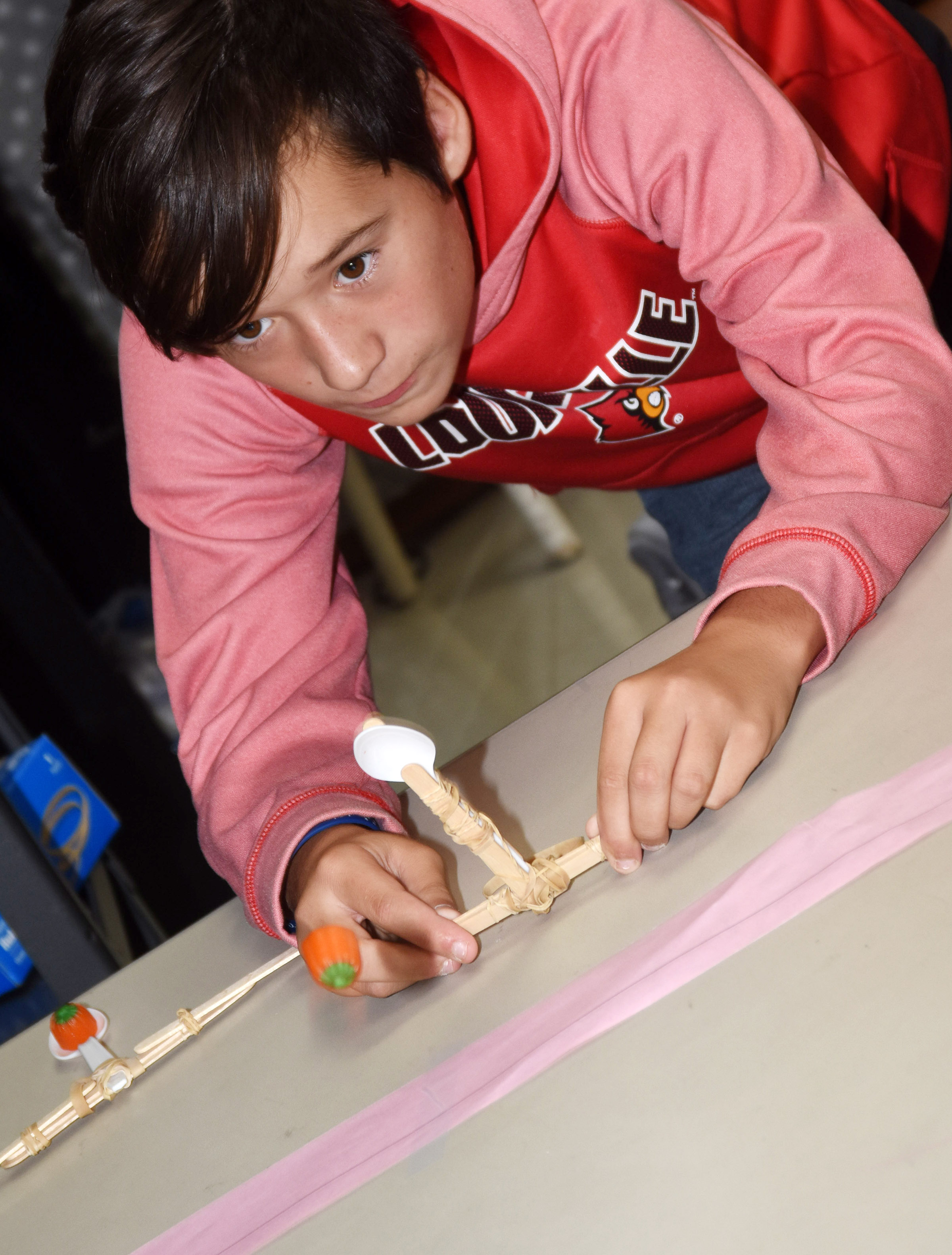 CMS sixth-grader Katon Cox fires his catapult.