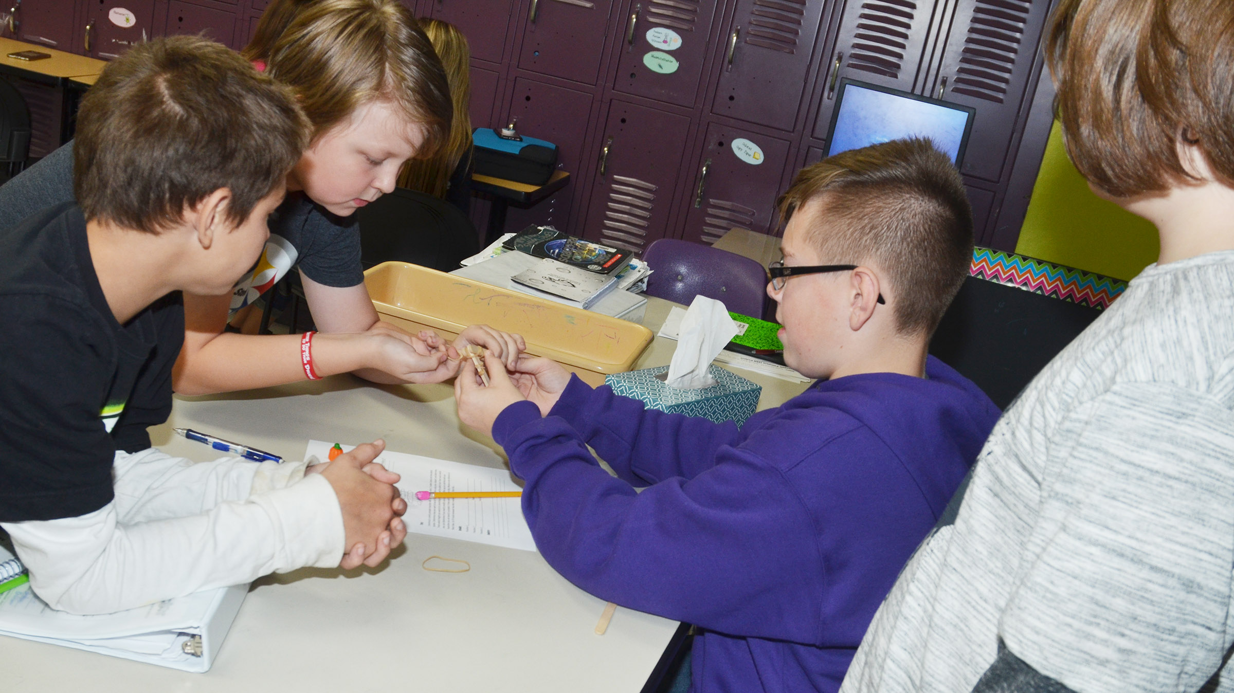 From left, CMS sixth-graders Ashtan Forrest, Zachary Akin, Jovi Bowen and Kayden Birdwell build their catapult.