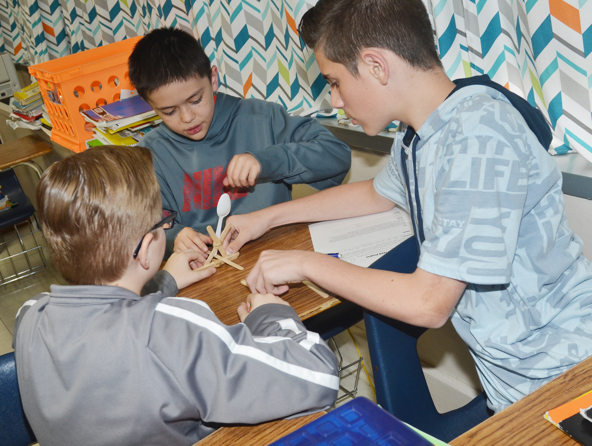 CMS sixth-graders, from left, Caleb Holt, Isacc Billeter and Isaac Garrison build their catapult.