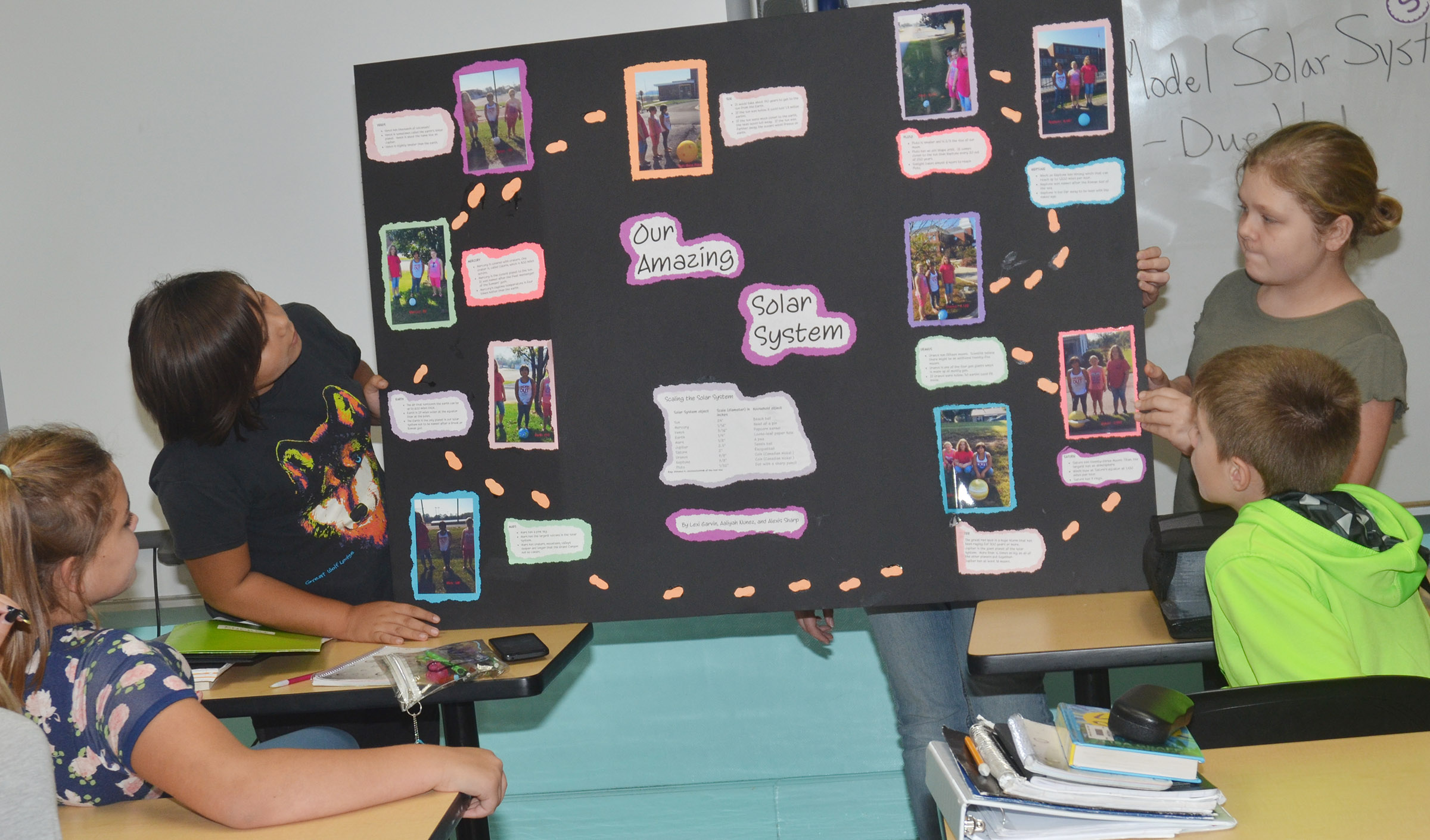 CMS sixth-graders Aaliyah Nunez, at left, and Alexis Sharp present about the solar system.