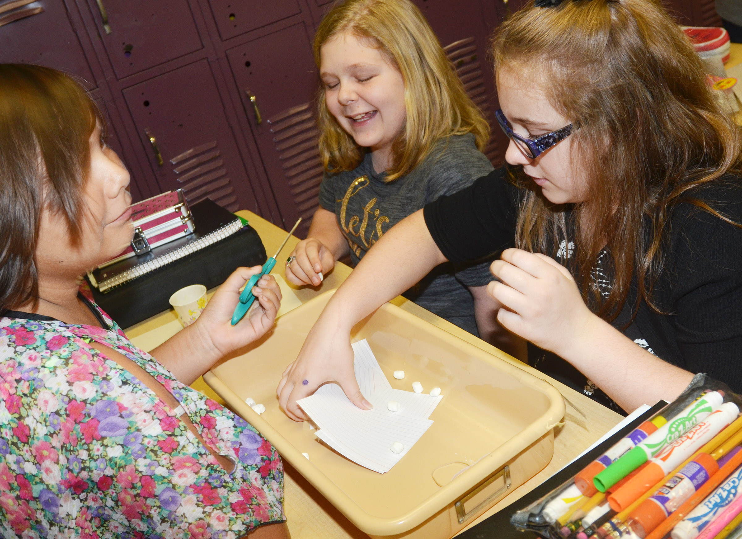 CMS sixth-graders, from left, Aaliyah Nunez, Alexis Sharp and Lexi Garvin build their spacecraft.