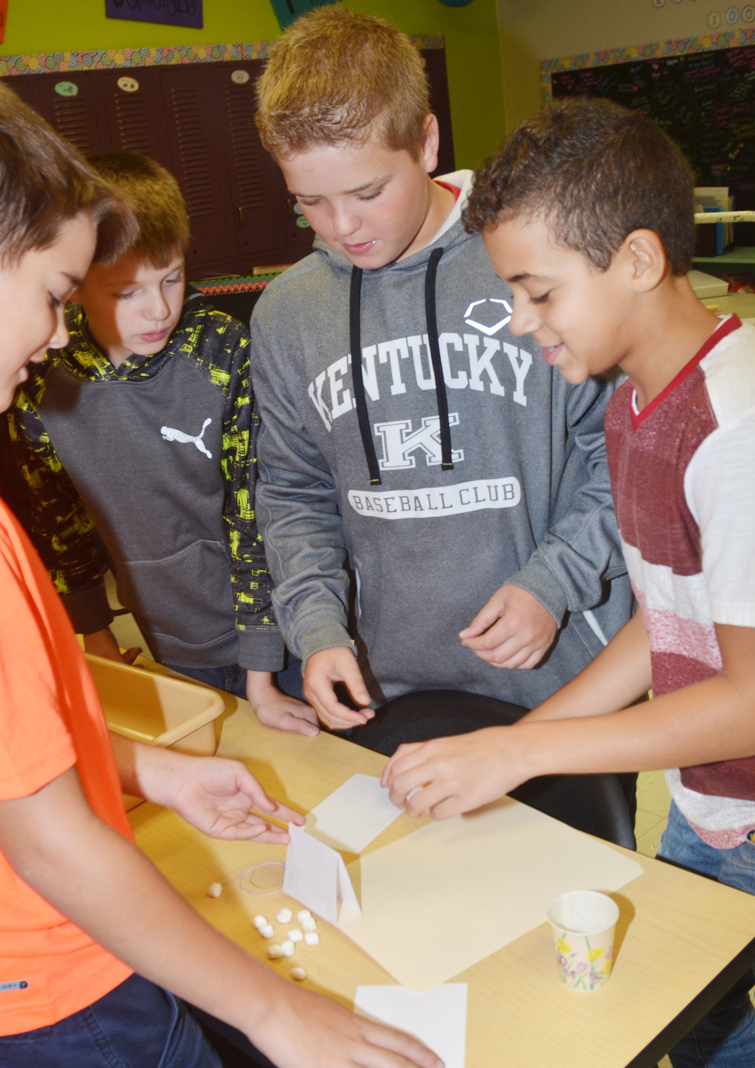 CMS sixth-graders, from left, Kaden Bloyd, Ethan Murphy, Ryan Grubbs and Tucker Cartwright build their spacecraft.