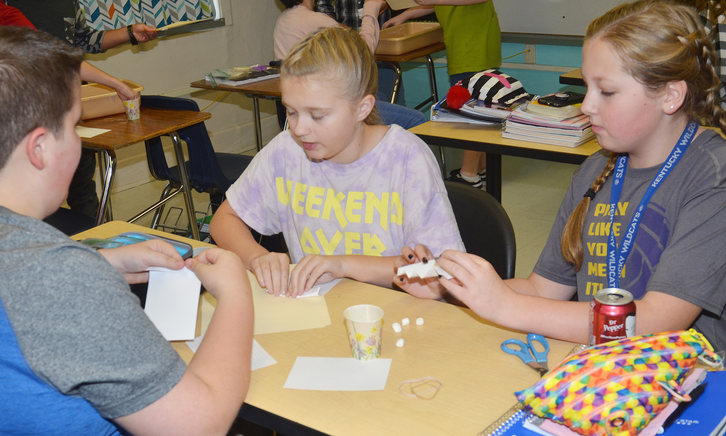 From left, CMS sixth-graders Luke McDonald, Lillee Byrne and Ava Hughes build their spacecraft.