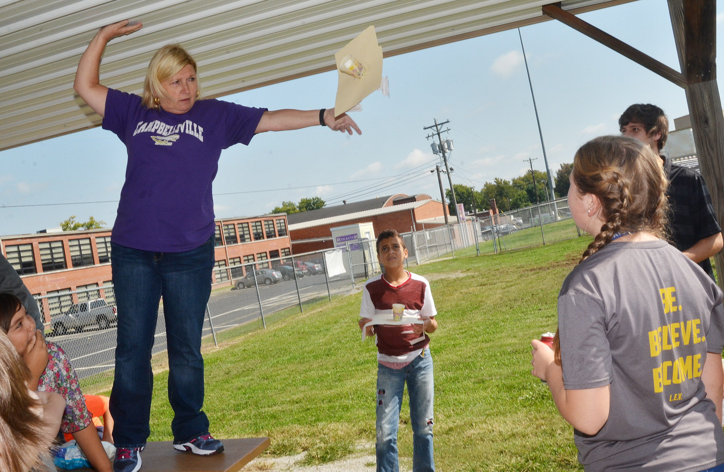 CMS sixth-grade teacher Jan Speer drops a group's spacecraft.