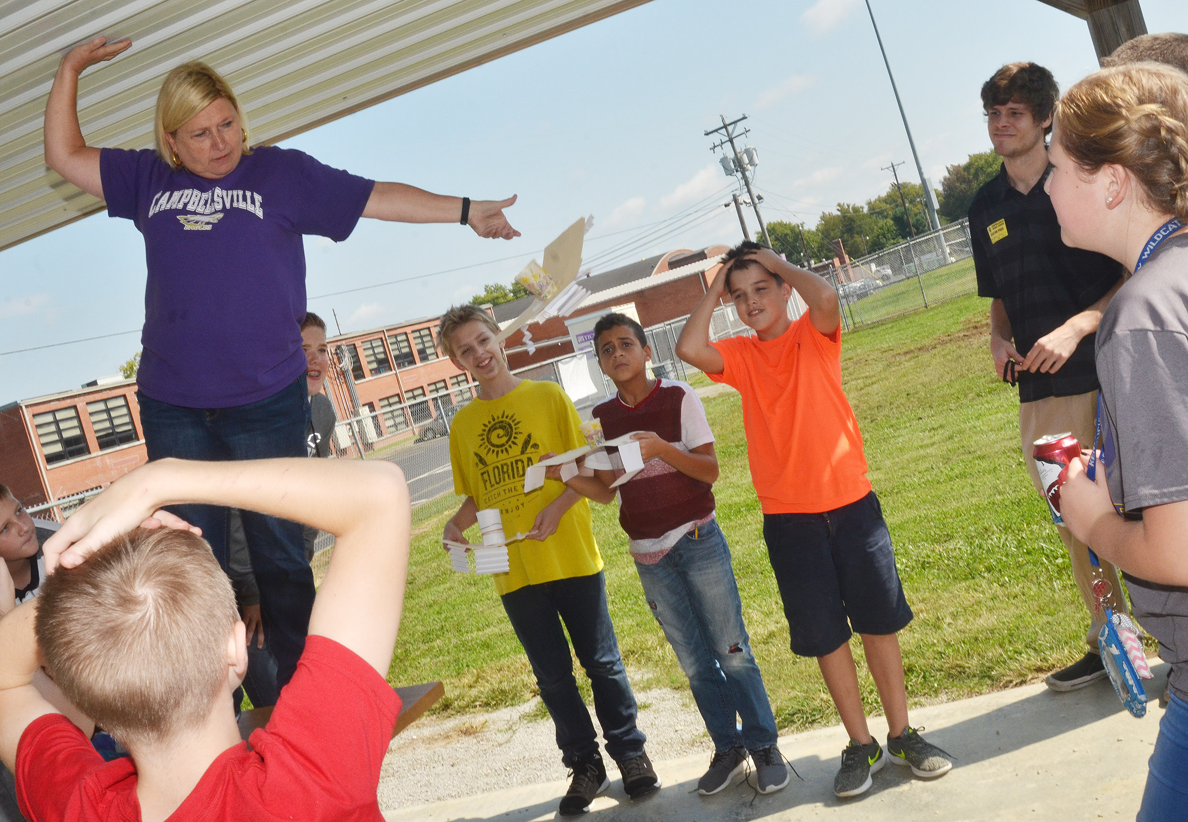 CMS sixth-grade teacher Jan Speer drops a spacecraft, as, from left, Ryan Grubbs, Jacob Releford, Tucker Cartwright and Kaden Bloyd watch.
