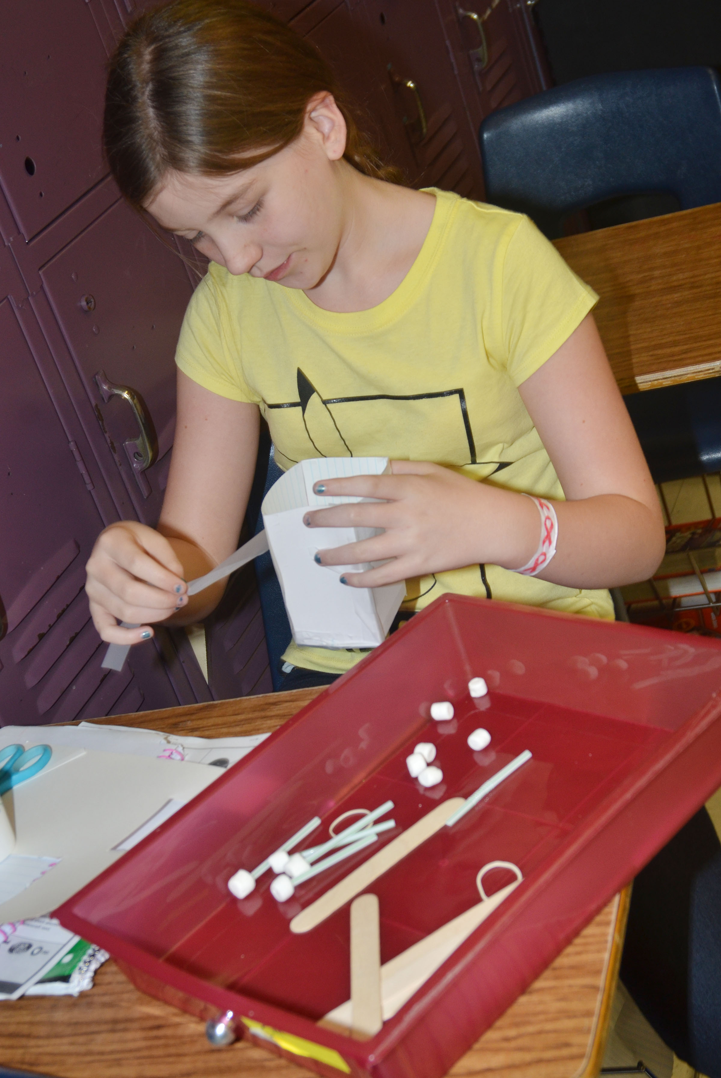 CMS sixth-grader Mikaela Scharbrough builds her group's spacecraft.