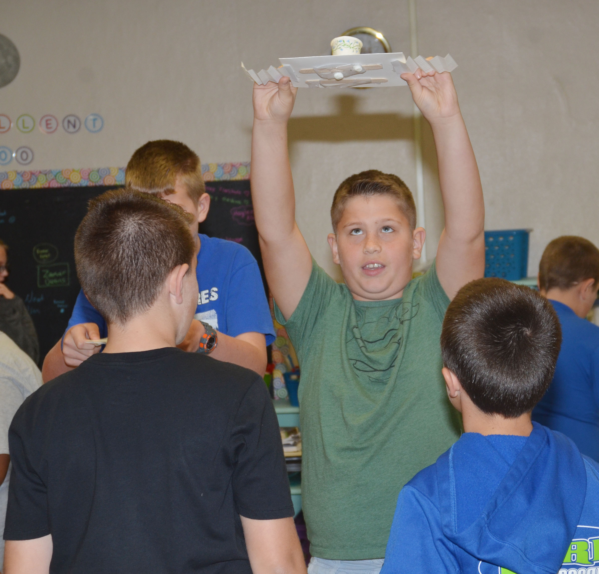 CMS sixth-grader Weston Mattingly tests his group's spacecraft.