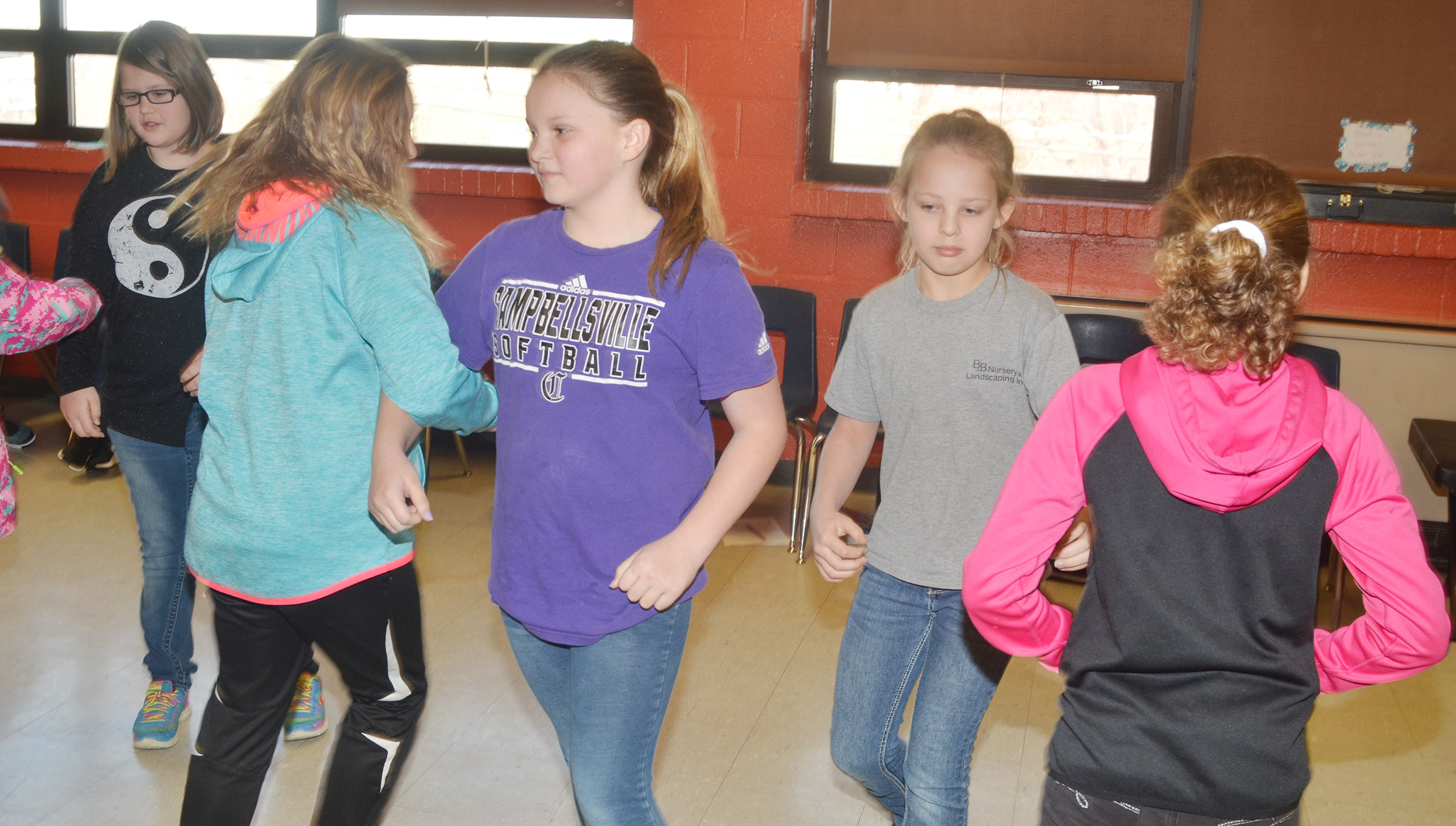CMS seventh-grader Graci Crews, center, and sixth-grader Gabrielle Bright dance with their partners.