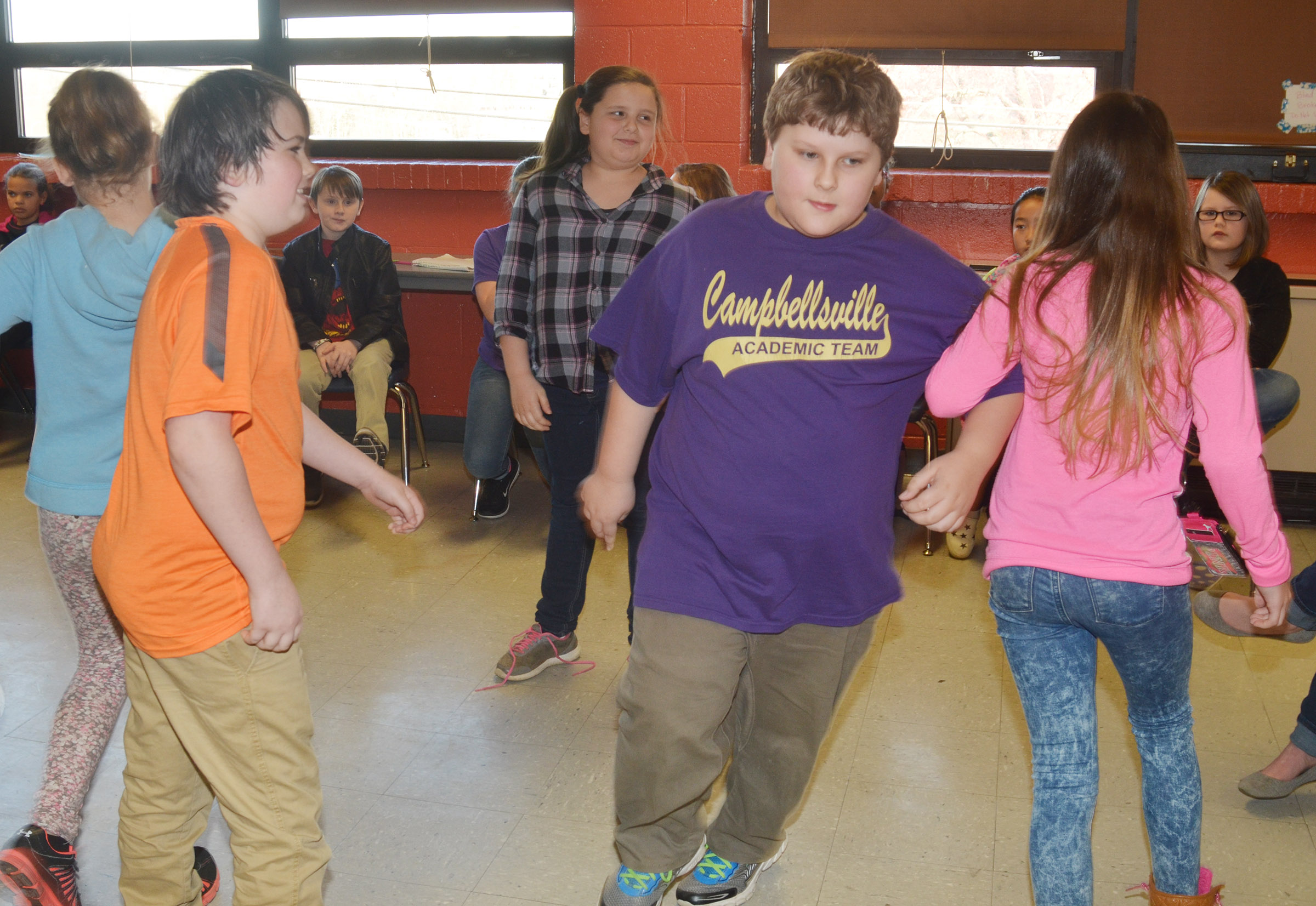 CMS fourth-grader Zeke Harris dances with his partner.
