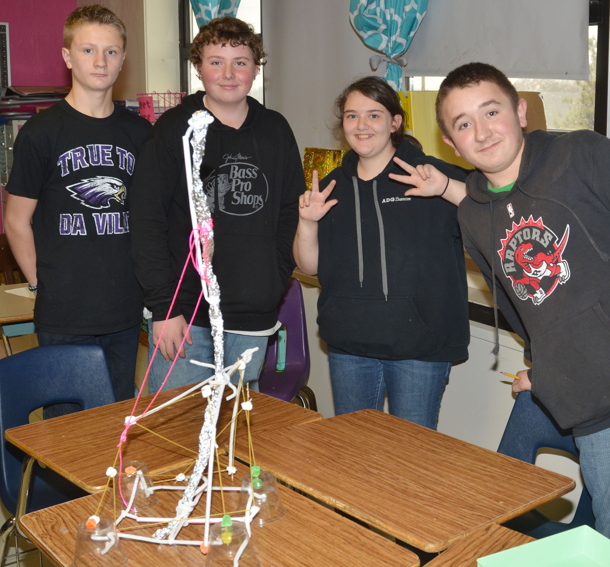 This structure, built by, from left, CMS eighth-graders Jake Dicken, Alex Howard, Haley Lopez and Zachary Shaw, was the tallest in the class.