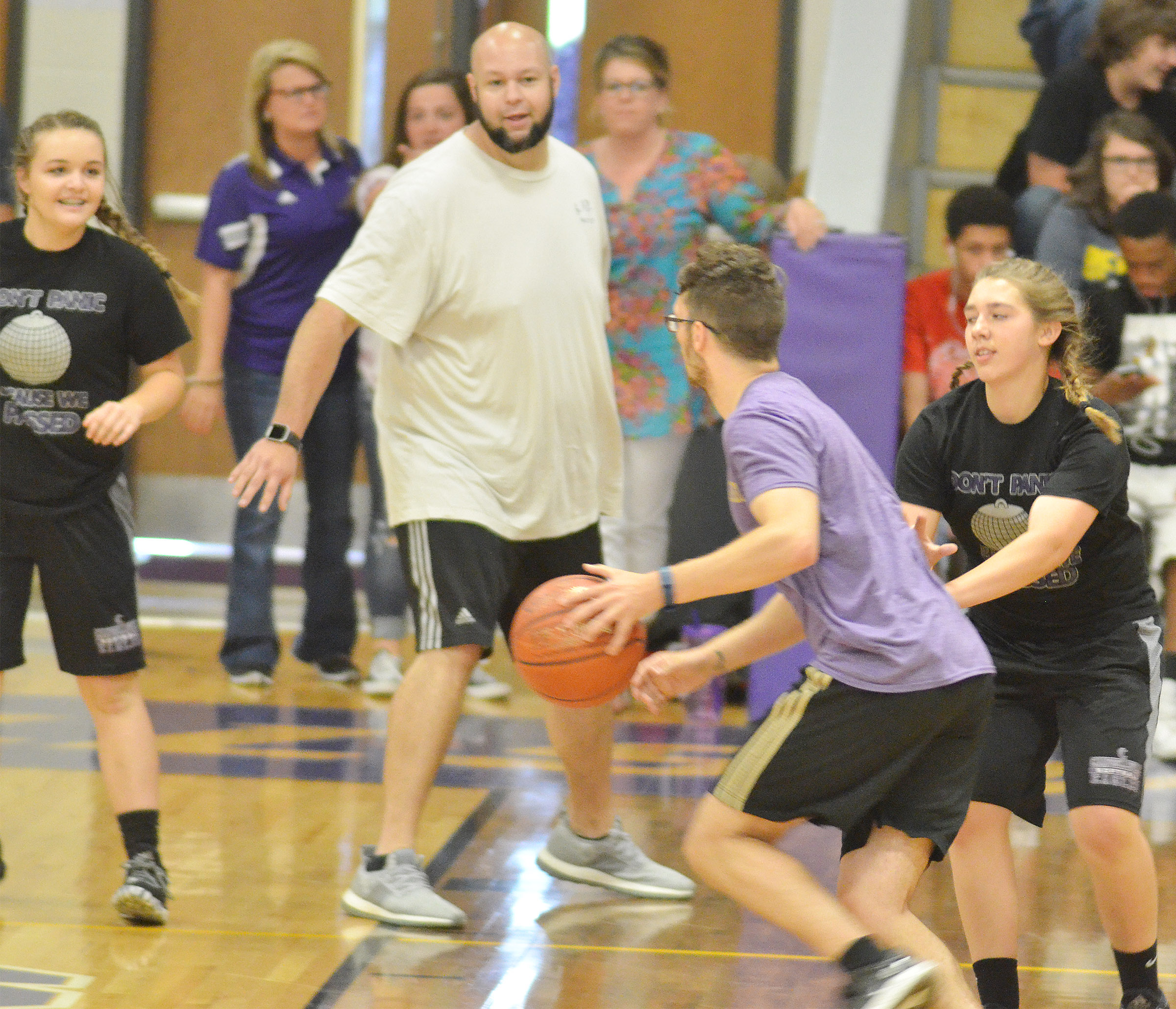 CMS eighth-grader Abi Wiedewitsch guards Campbellsville High School instructional assistant Cody Wills as Kenzi Forbis, at left, guards teacher Zach Shelton.
