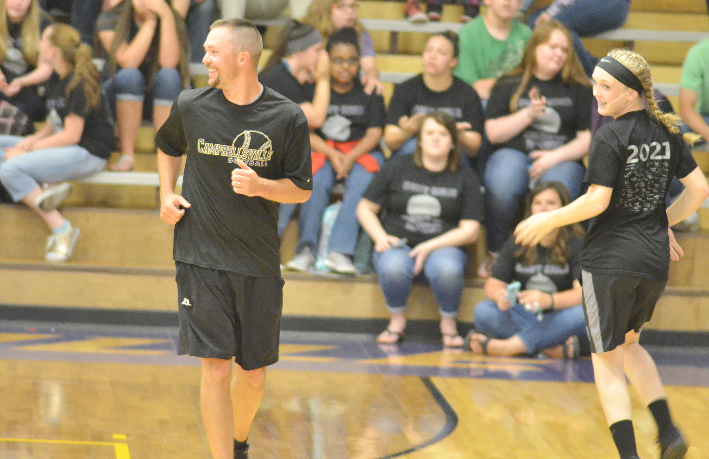 CMS eighth-grader Catlyn Clausen guards teacher Weston Jones.
