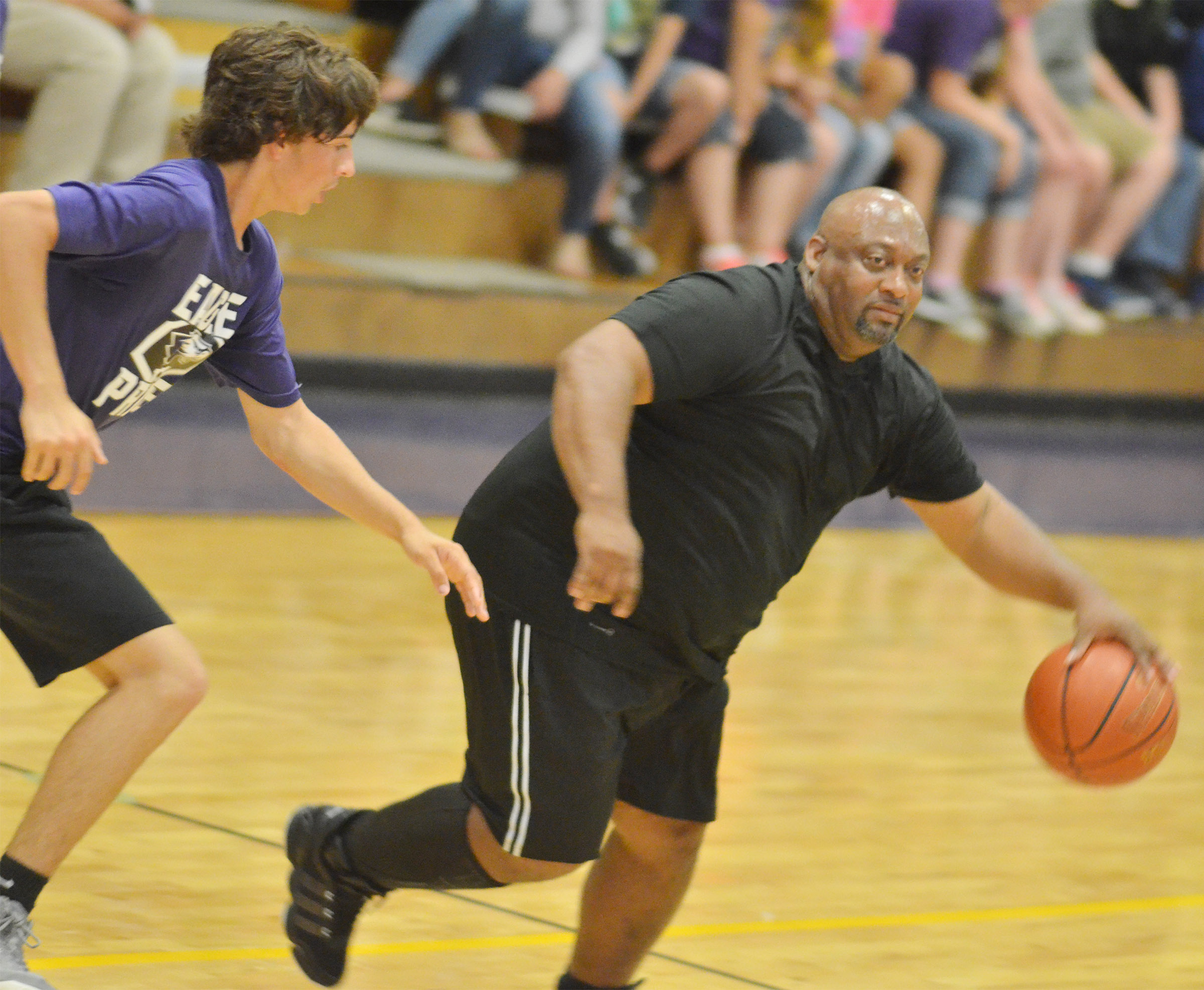 CMS eighth-grader John Orberson guards Campbellsville High School instructional assistant Joseph Taylor.