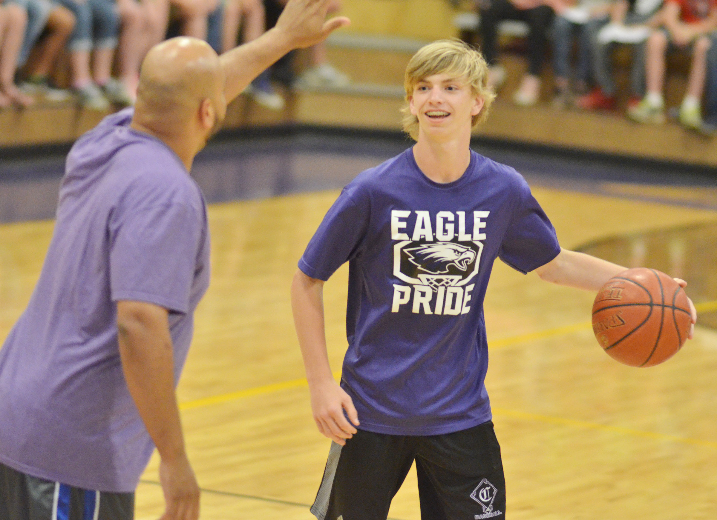 CMS eighth-grader Arren Hash dribbles as Campbellsville Elementary School cafeteria worker Aaron Webb guards him.