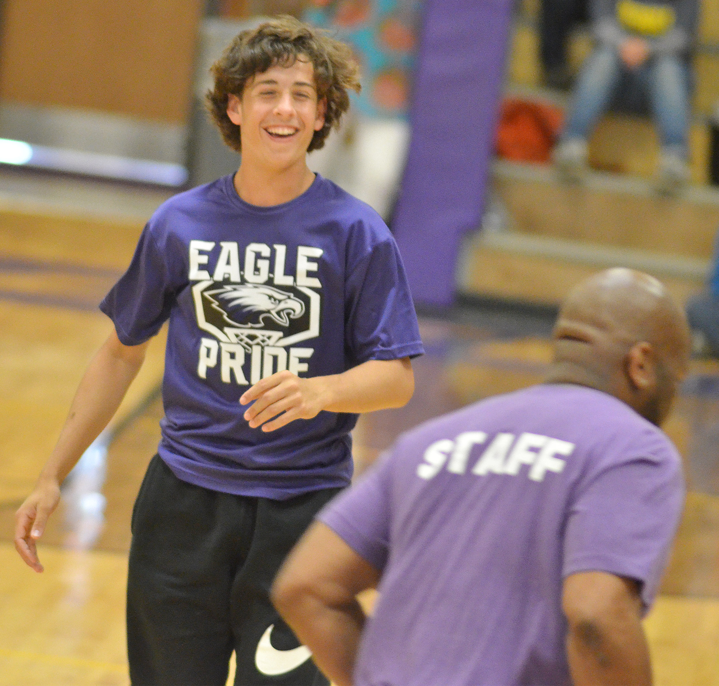 CMS eighth-grader John Orberson laughs as he guards CMS exceptional education teacher Anthony Epps.