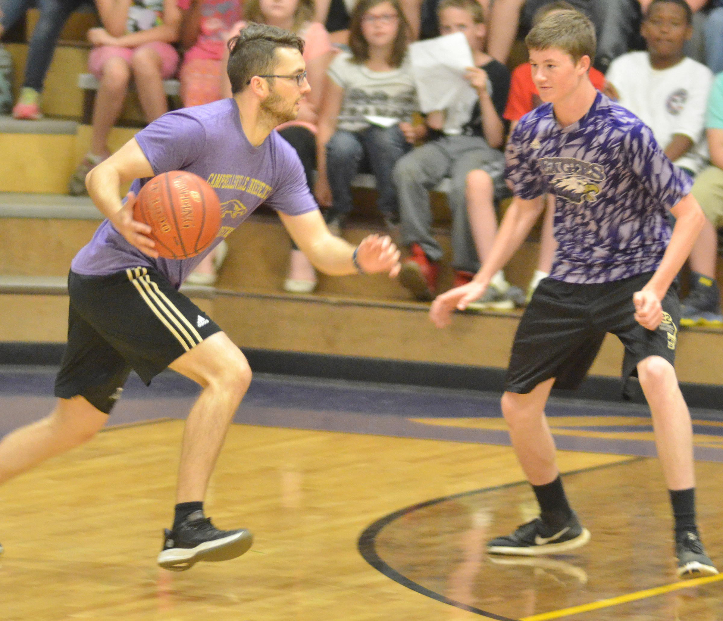 CMS eighth-grader Tristin Faulkner guards Campbellsville High School instructional assistant Cody Wills.