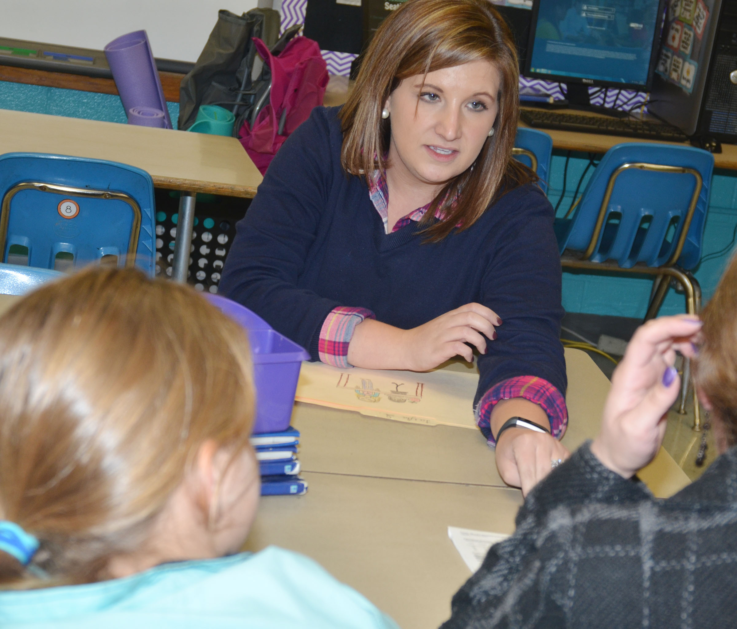 CMS fifth-grade teacher Jessica Lile talks with a parent.