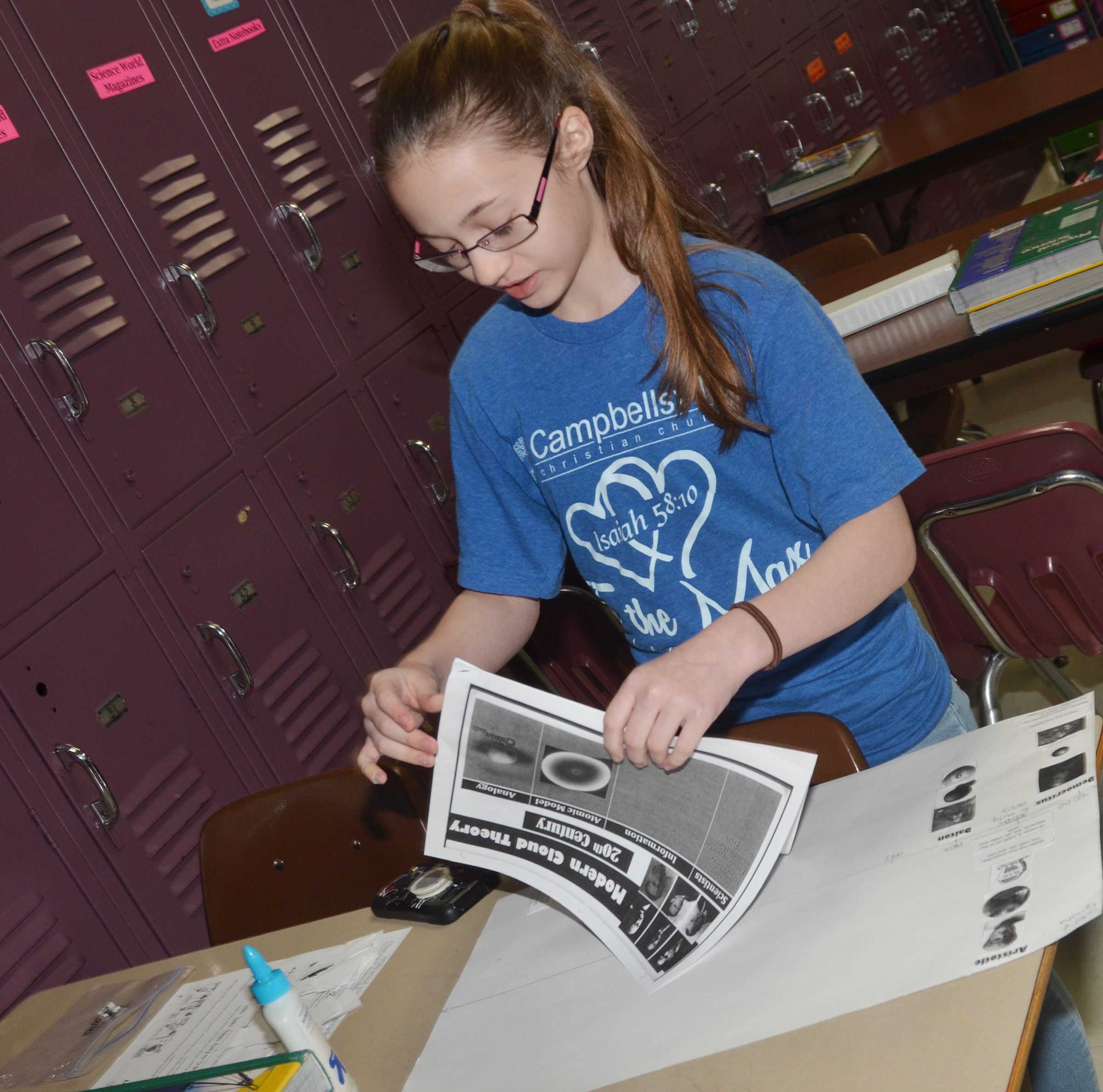 CMS eighth-grader Cailet Clark works on a project for her science class during the after-school study session on Friday, Oct. 27.