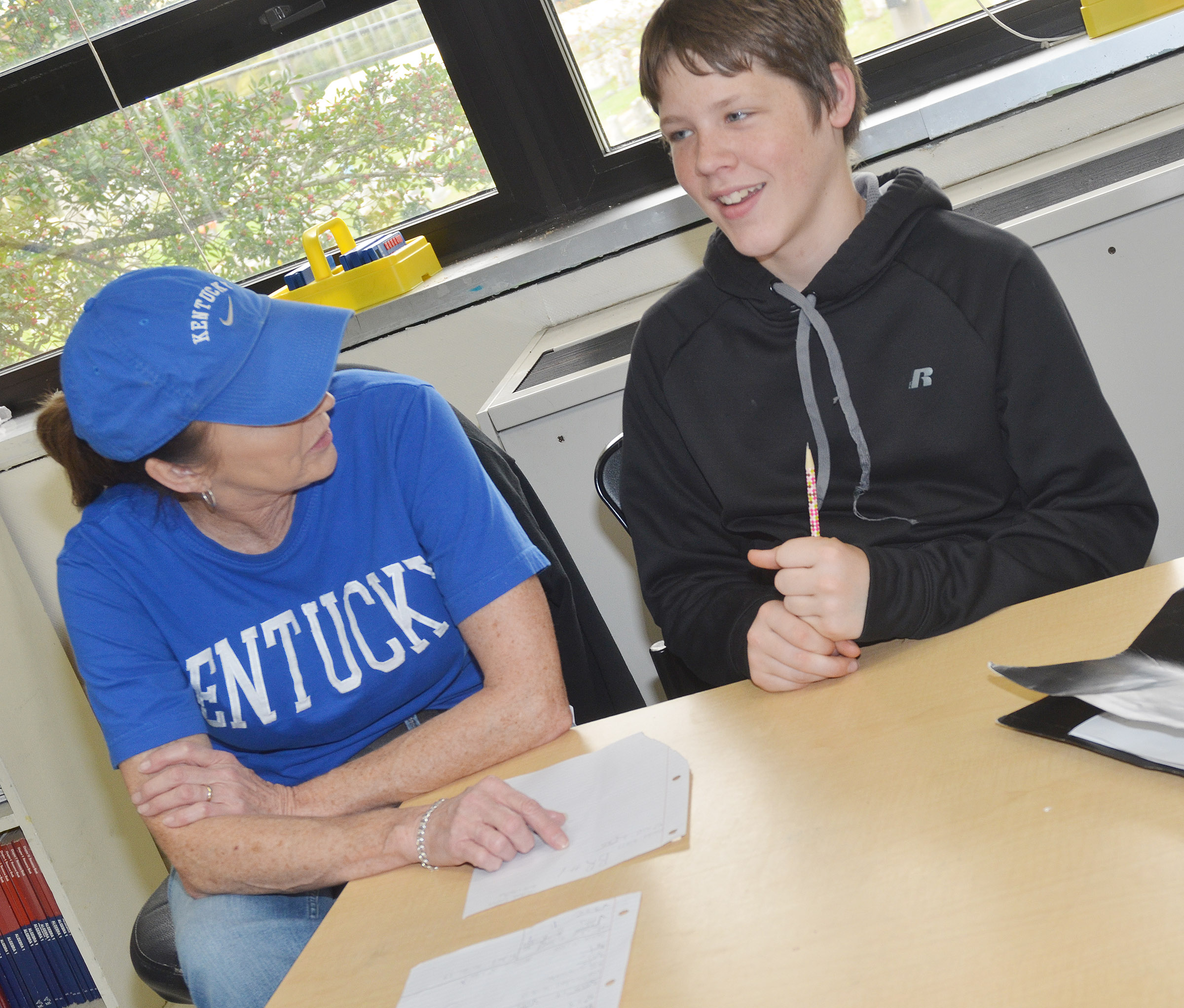CMS eighth-grade teacher Melisa Morris works on homework with Josh Lucas.