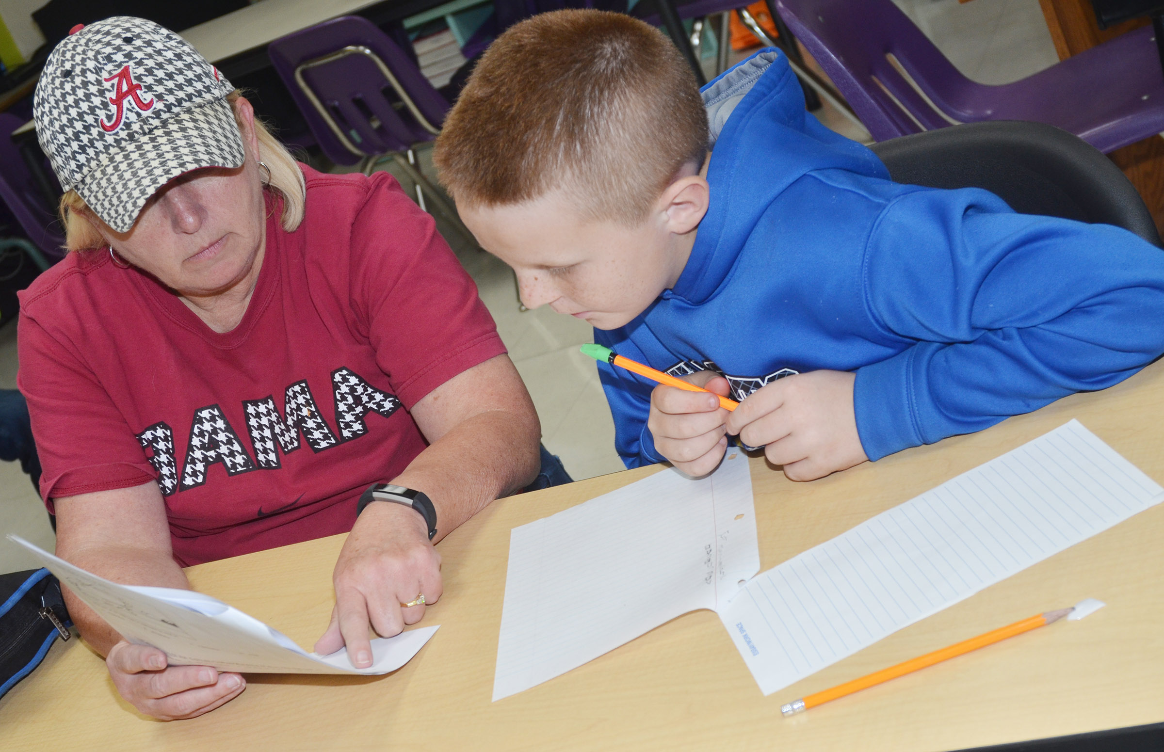 CMS sixth-grade teacher Jan Speer works with Jason Jeffries during the after-school study session on Friday, Oct. 27.