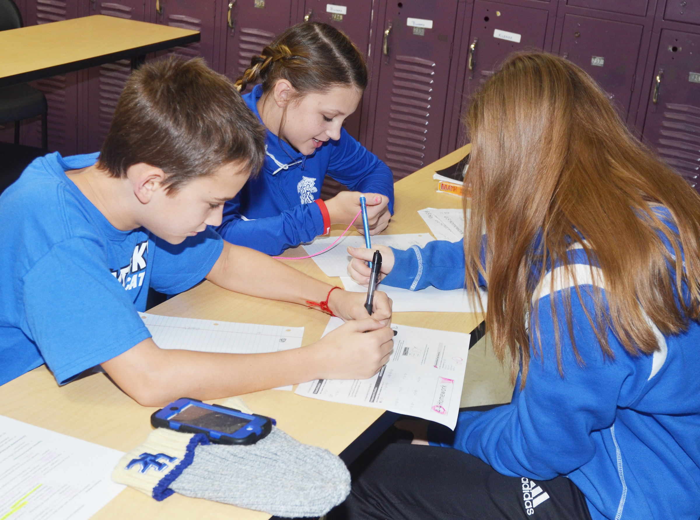 From left, CMS seventh-graders Camren Vicari, Alexis Byers and Alysa Howard work on a project together during the after-school study session on Friday, Oct. 27.