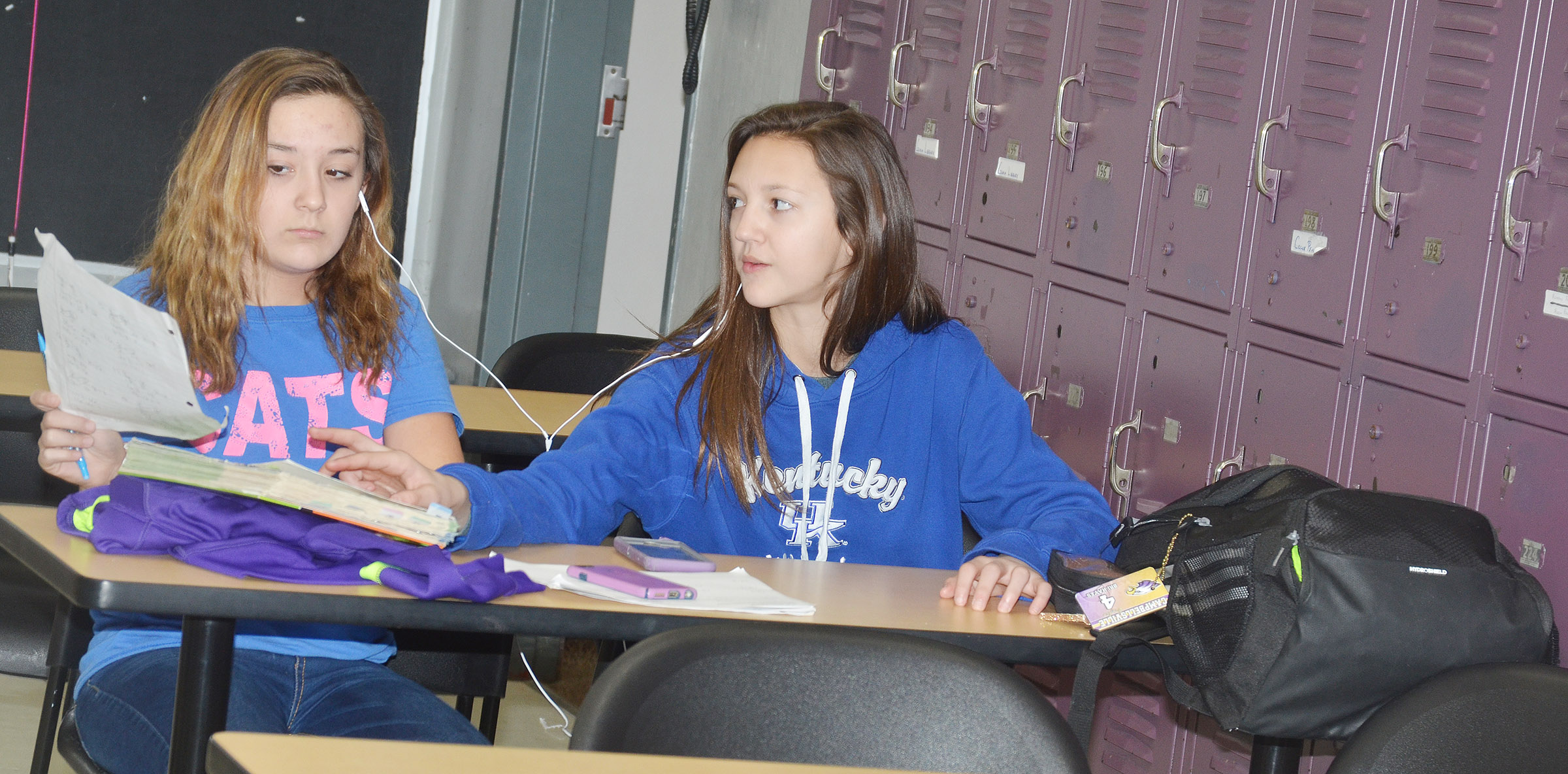 CMS seventh-graders Briana Davis, at left, and Bri Hayes work together on an assignment.