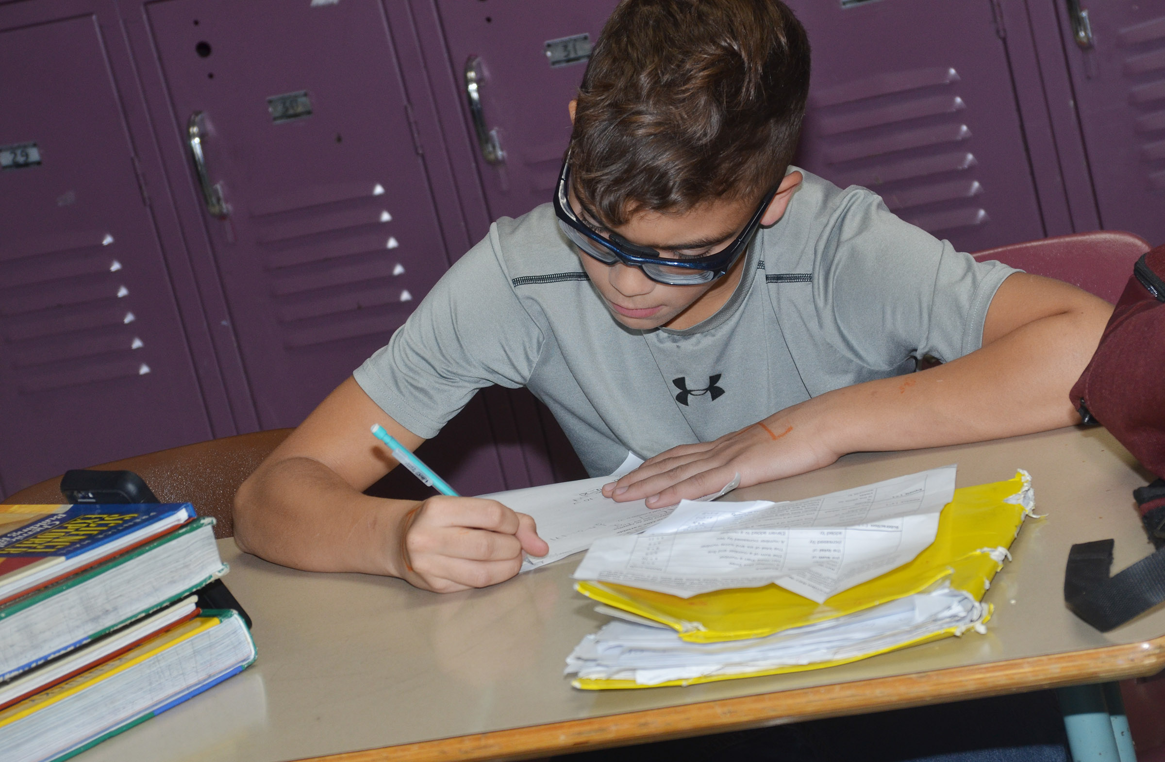 CMS eighth-grader Logan Phillips completes an assignment.