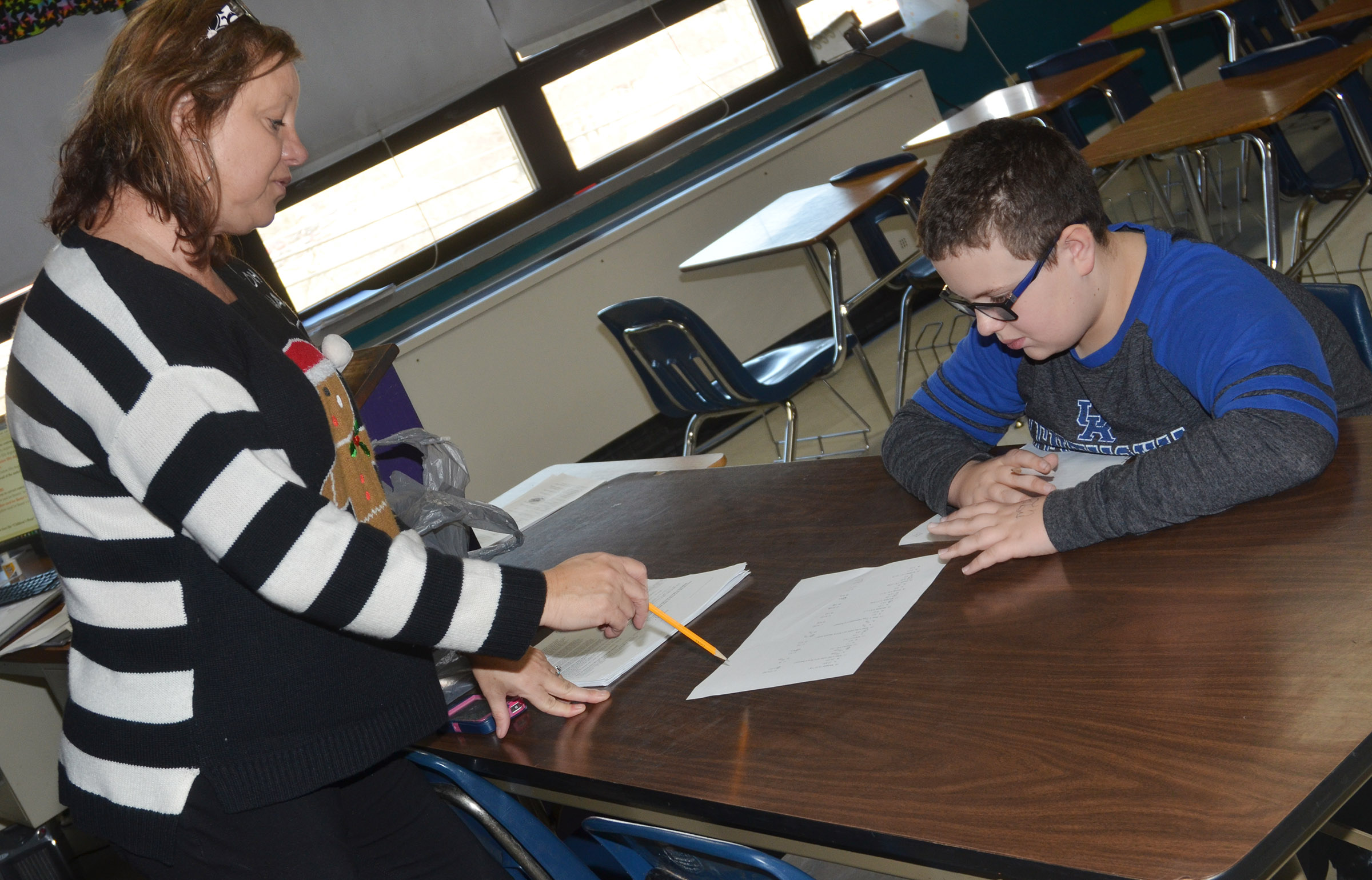 CMS teacher Sharon Harris works with sixth-grader Daniel Caton as he completes a math problem.