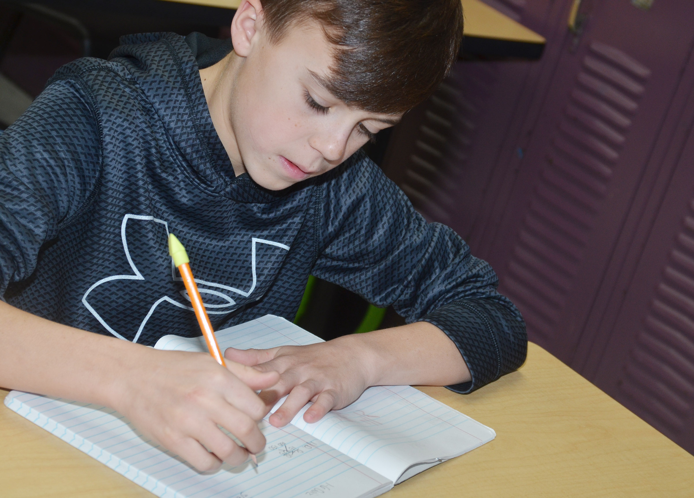 CMS seventh-grader Chase Hord works on a math assignment.