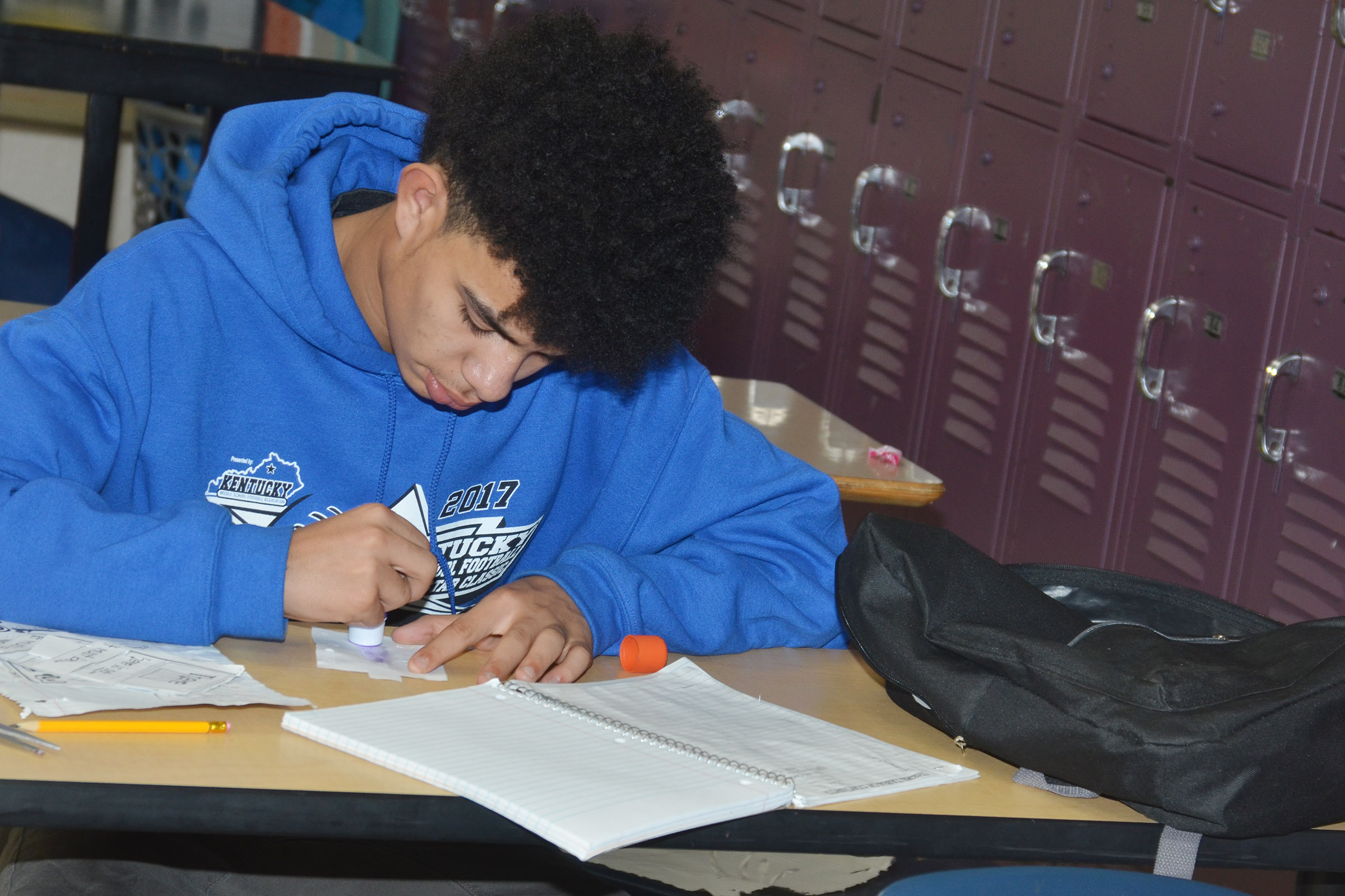 CMS eighth-grader Blake Settle works on an assignment.