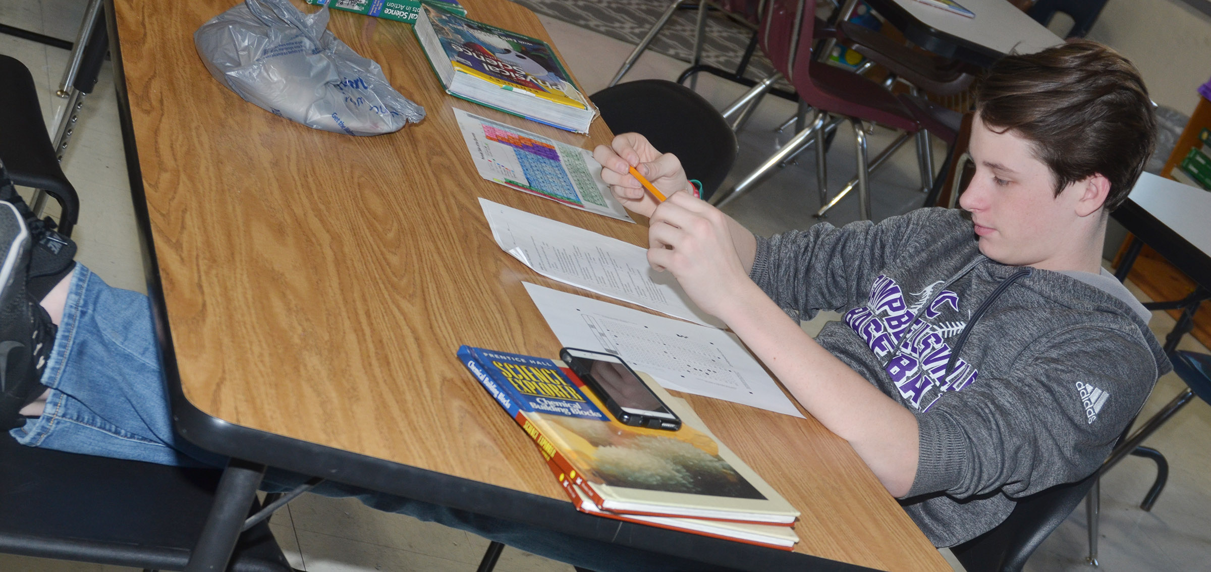 CMS seventh-grader Seth Hash completes an exam.