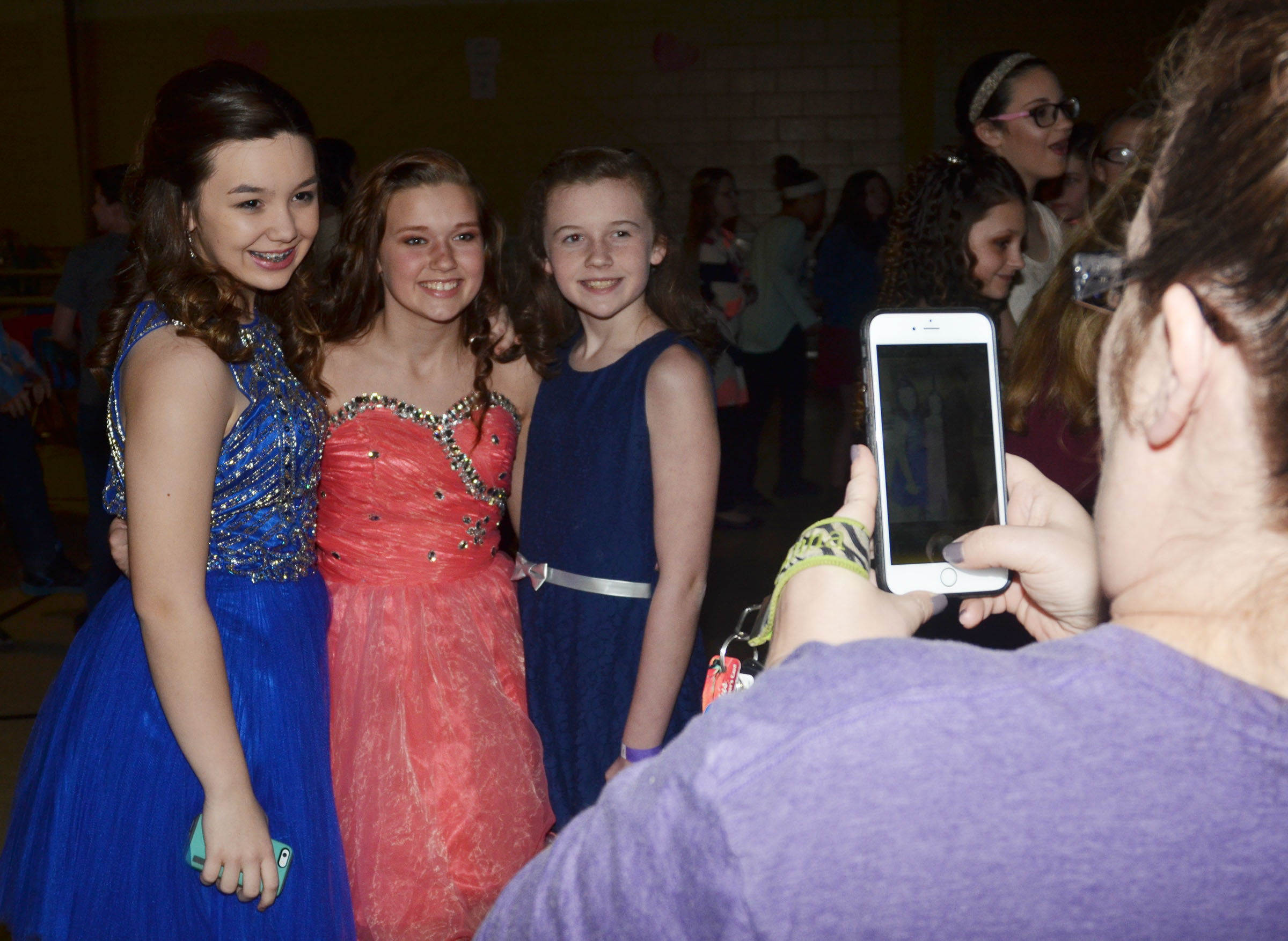 CMS sixth-graders, from left, Olivia Fields, Breanna Humphress and Dakota Slone smile for the camera.