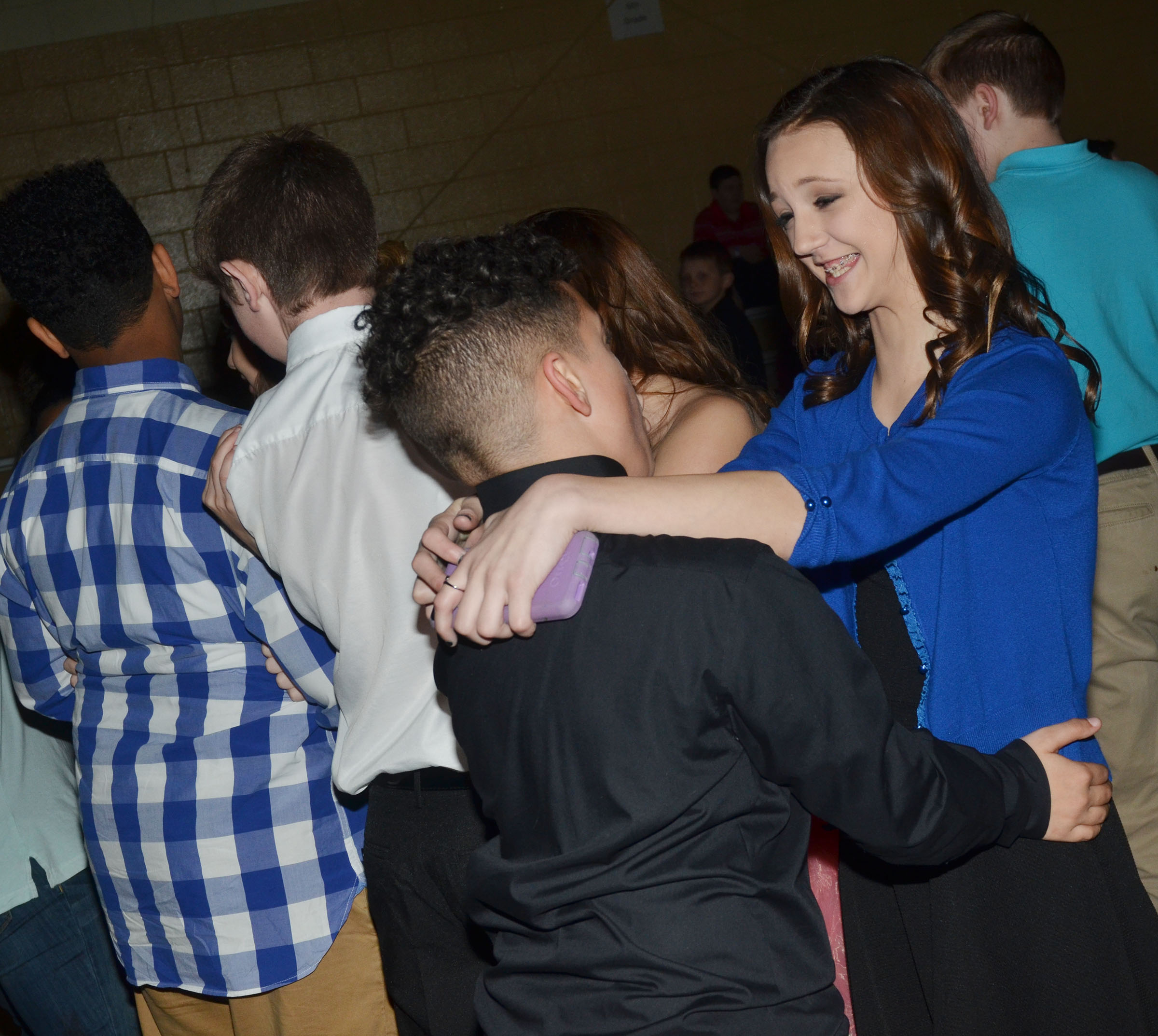 CMS sixth-graders Bri Hayes dances with classmate Kaydon Taylor.